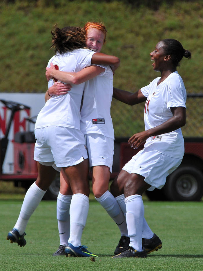 Huster celebrates with teammates after giving FSU an early 1-0 lead.