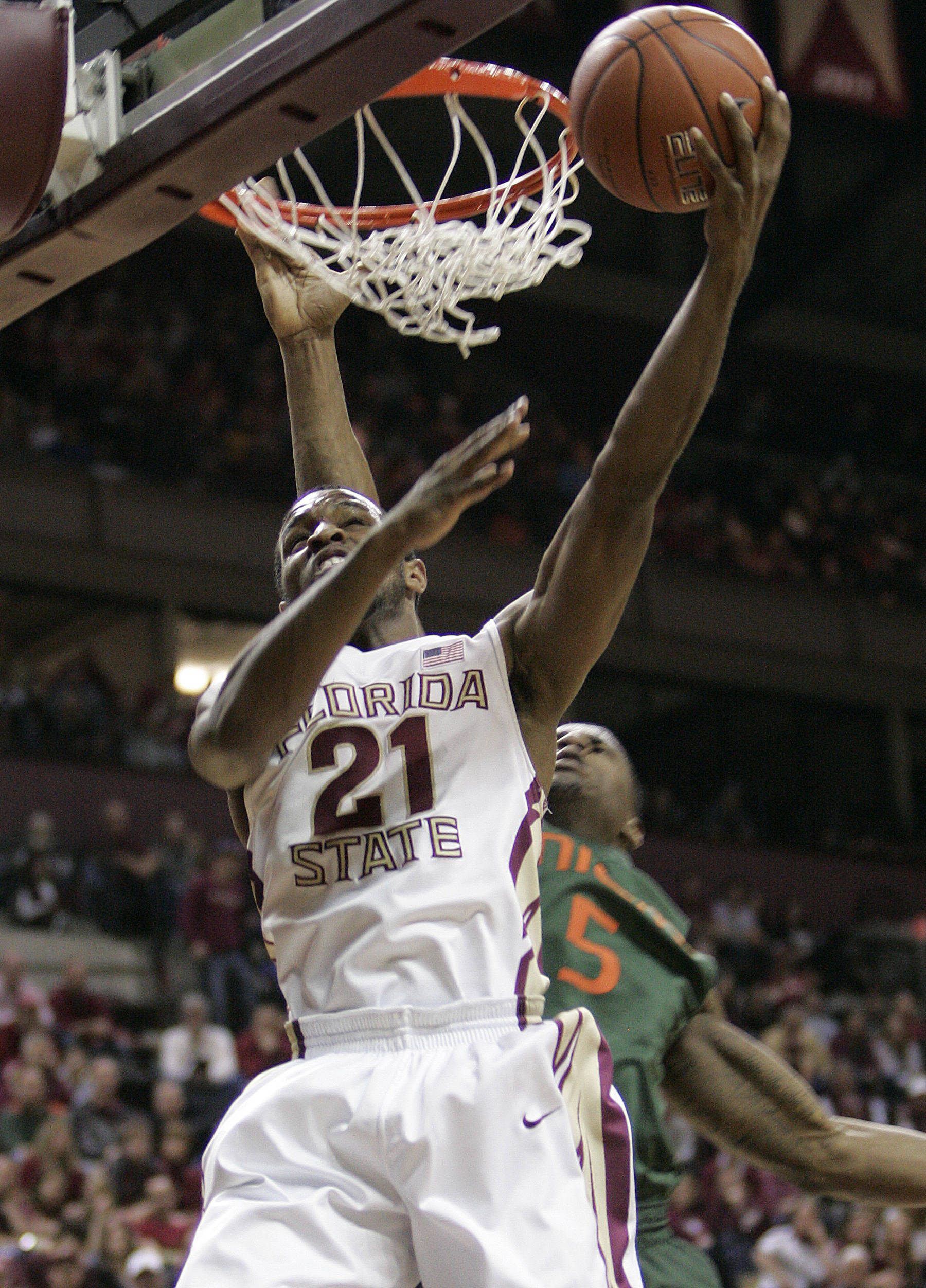 Florida State's Michael Snaer attempts a shot against the defense of Miami's Dequan Jones in the second half of an NCAA college basketball game on Saturday, Feb. 11, 2012 in Tallahassee, Fla.(AP Photo/Steve Cannon)