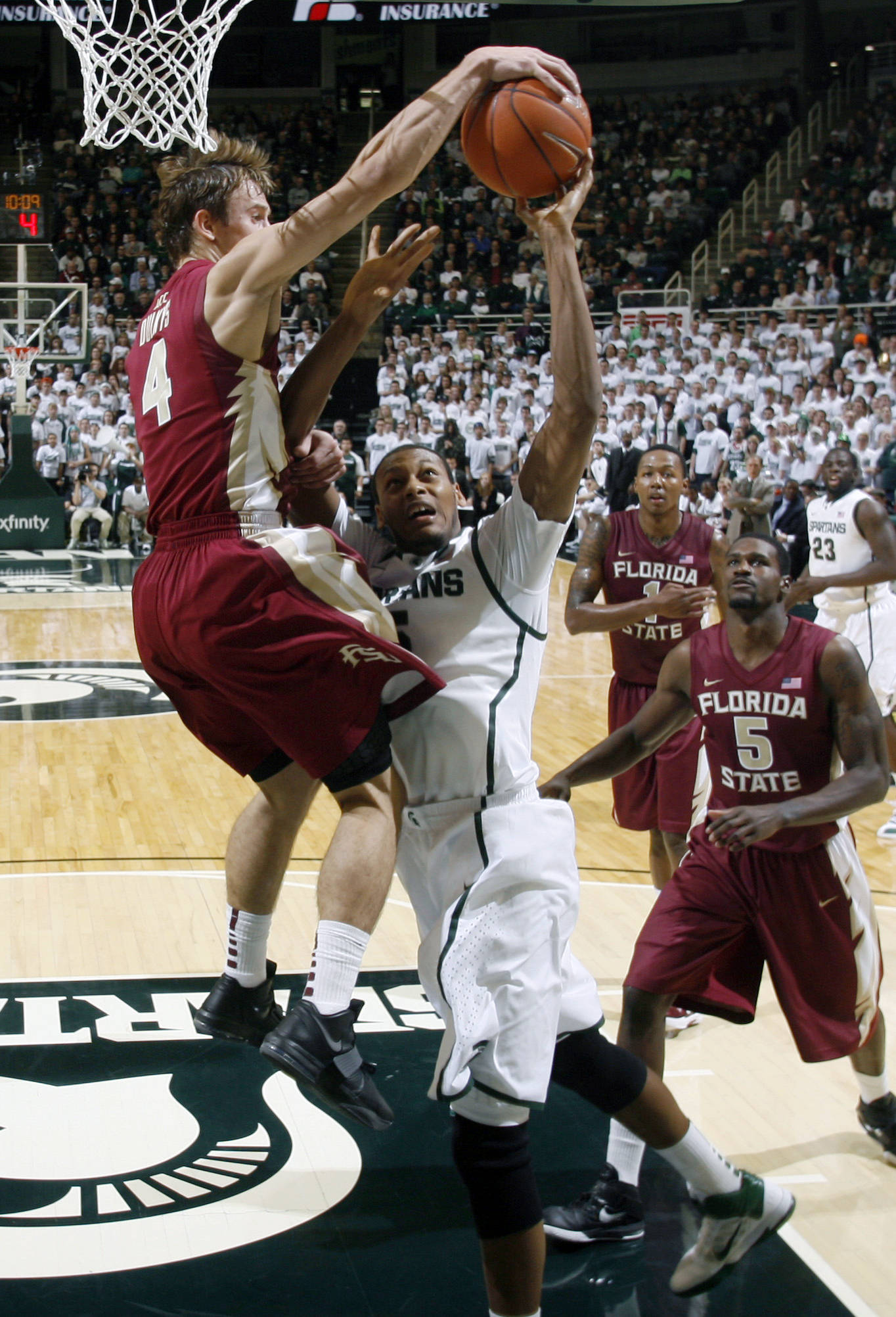 Florida State's Deividas Dulkys, left, blocks a shot by Michigan State's Adriean Payne during the first half of an NCAA college basketball game, Wednesday, Nov. 30, 2011, in East Lansing, Mich. (AP Photo/Al Goldis)