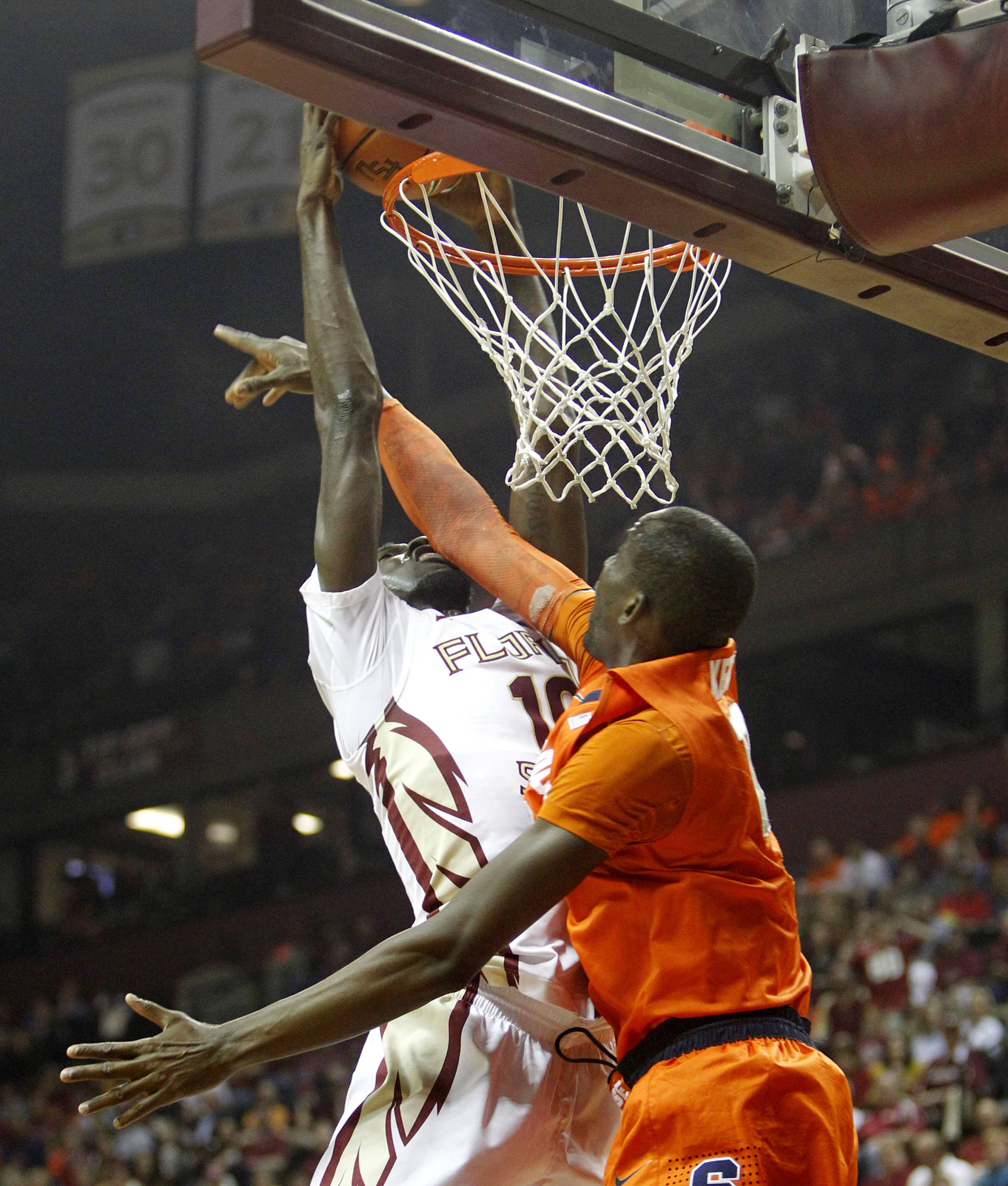 Mar 9, 2014; Tallahassee, FL, USA;  Florida State Seminoles forward Okaro White (10) dunks over Syracuse Orange center Baye-Moussa Keita (12) during the first half at Donald L. Tucker Center. Mandatory Credit: Matt Stamey-USA TODAY Sports