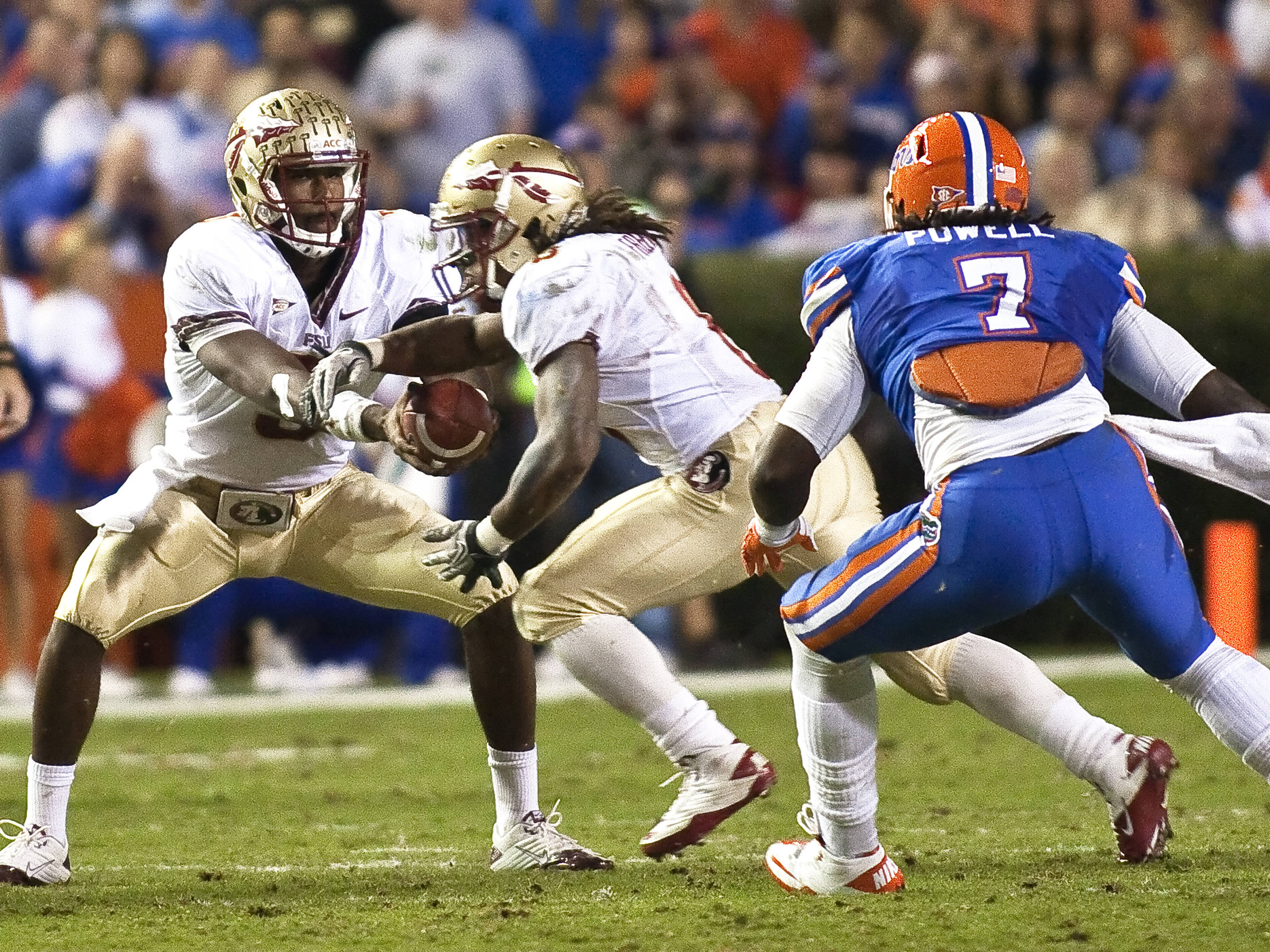 Quarterback EJ Manuel (3) handing off to Devonta Freeman (8),FSU vs Florida, 11/26/2011