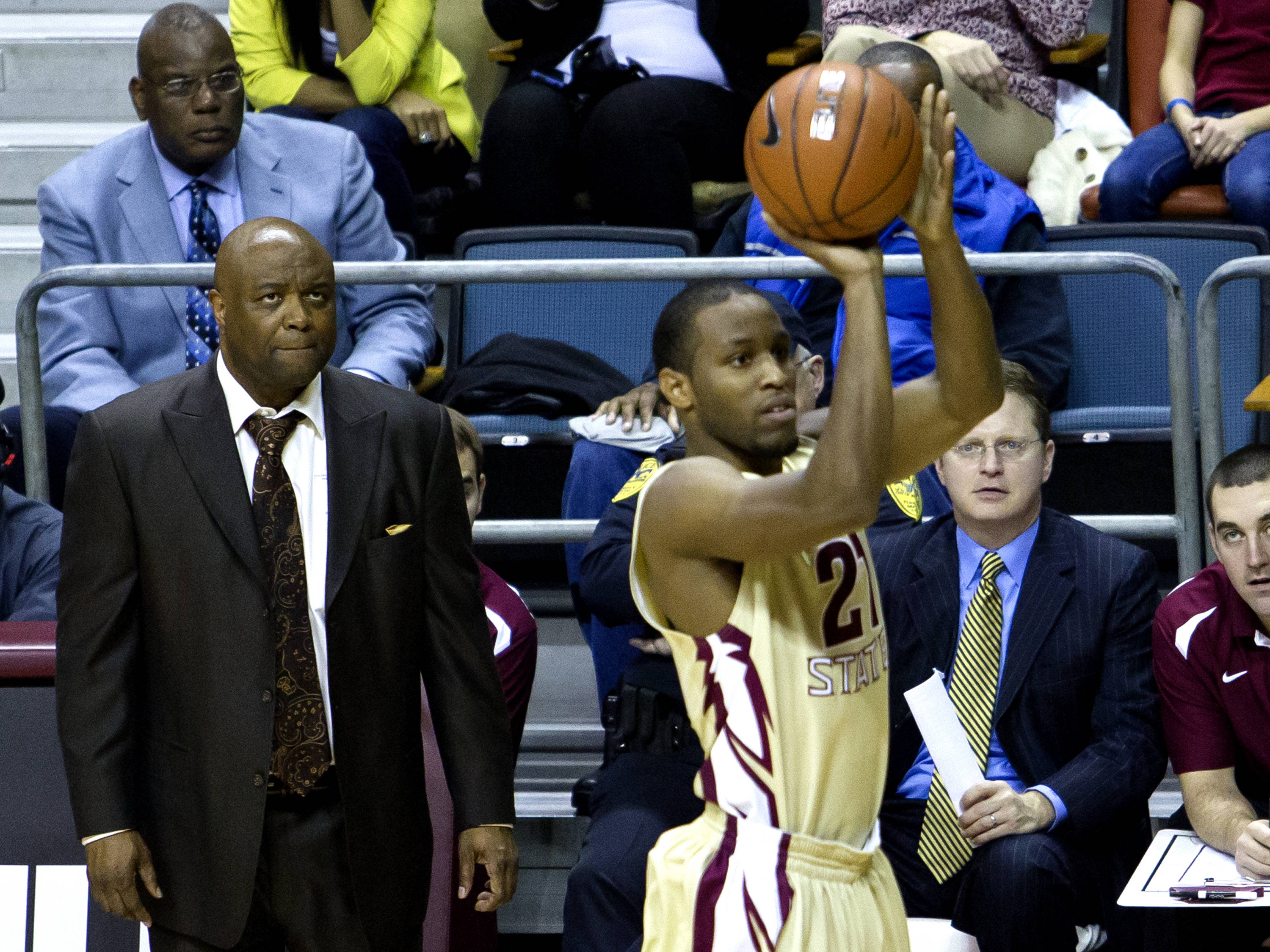 Head Coach Leonard Hamilton watching Michael Snaer (21) launch a 3 point shot, FSU vs BC, 02/16/13. (Photo by Steve Musco)