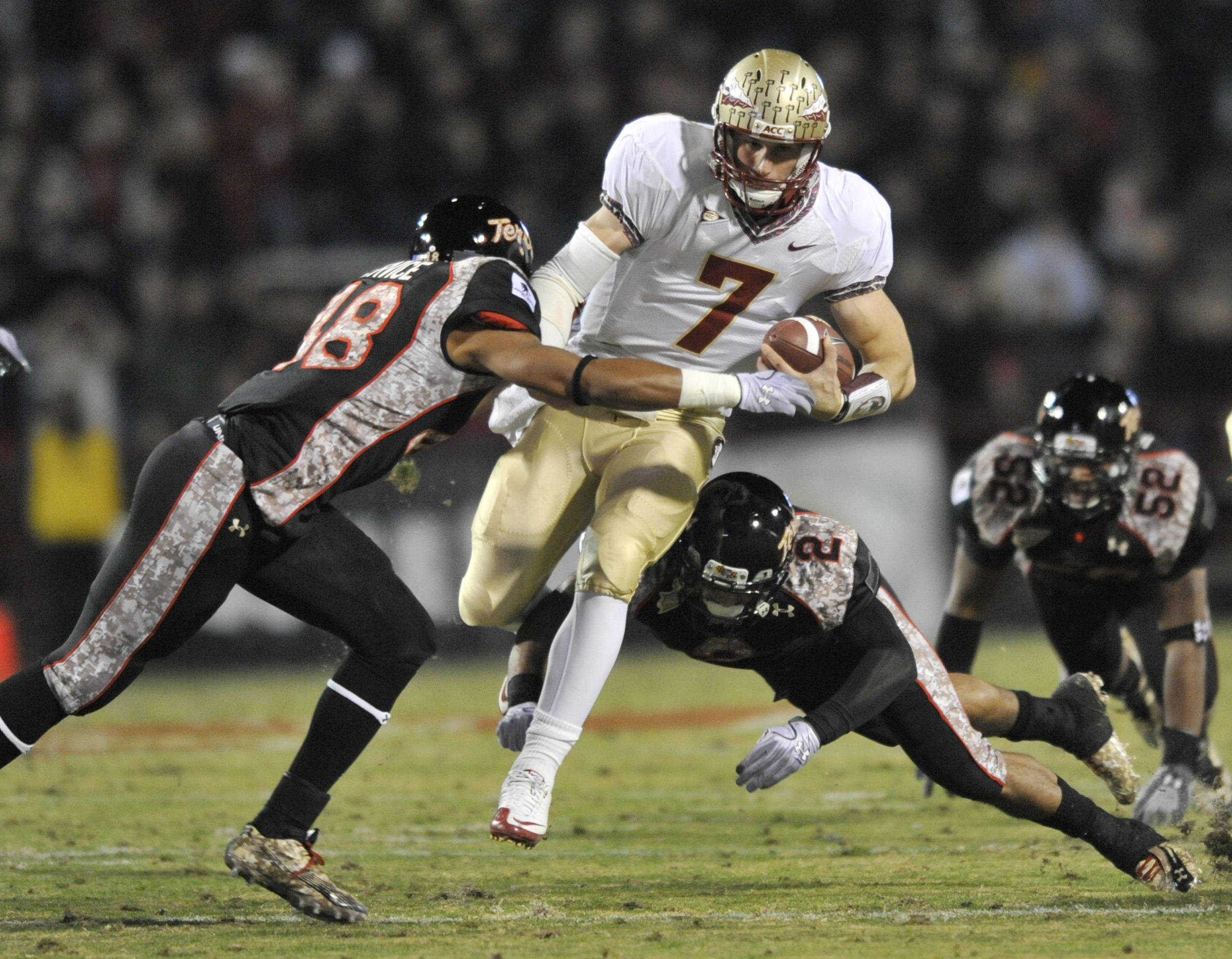 Maryland's Eric Franklin, left, and Antwine Perez tackle Florida State's quarterback Christian Ponder during the first half. (AP Photo/Gail Burton)