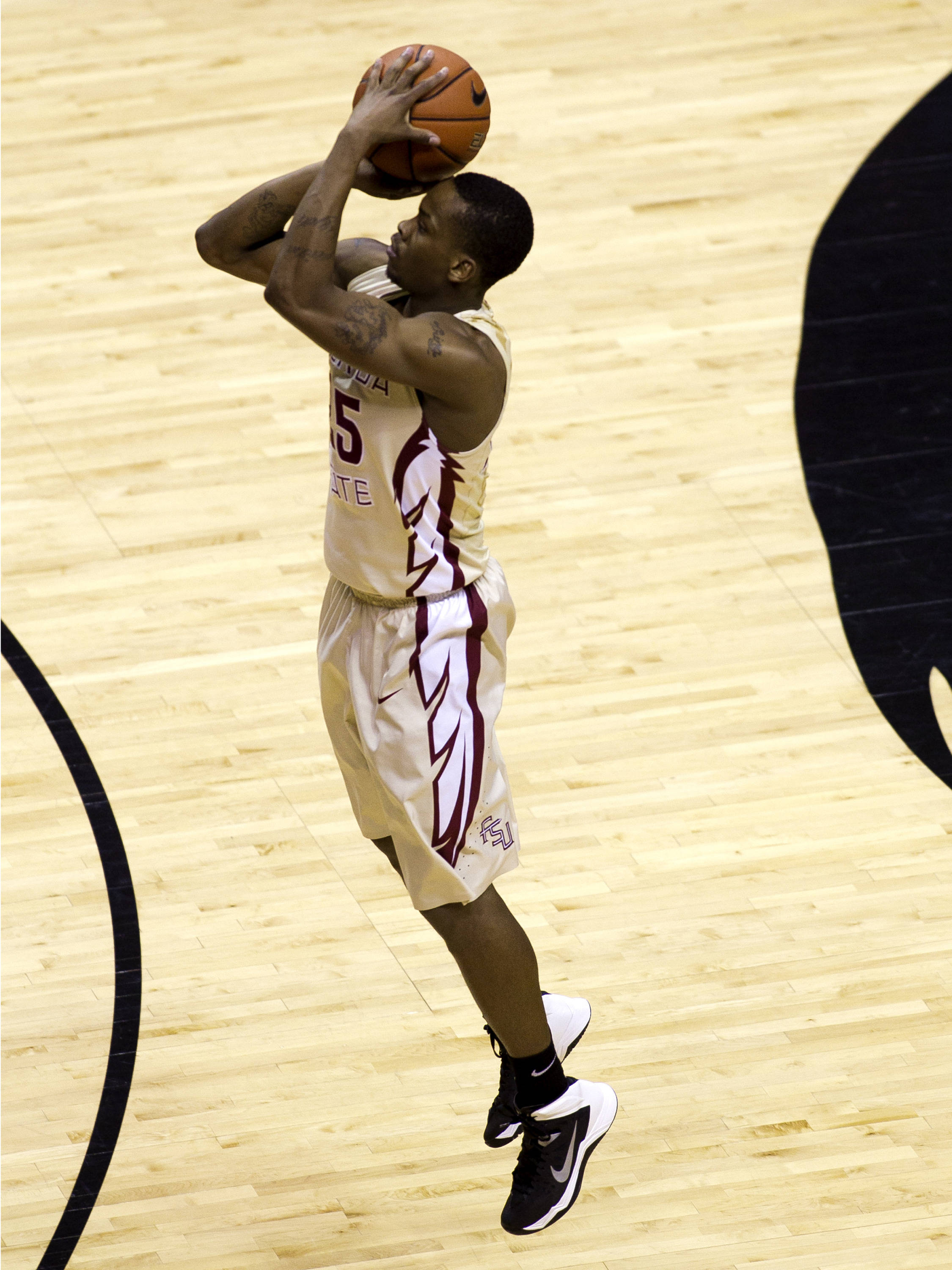 Aaron Thomas (25) releases a long three, FSU vs North Carolina, 2-17-14, (Photo's by Steve Musco)