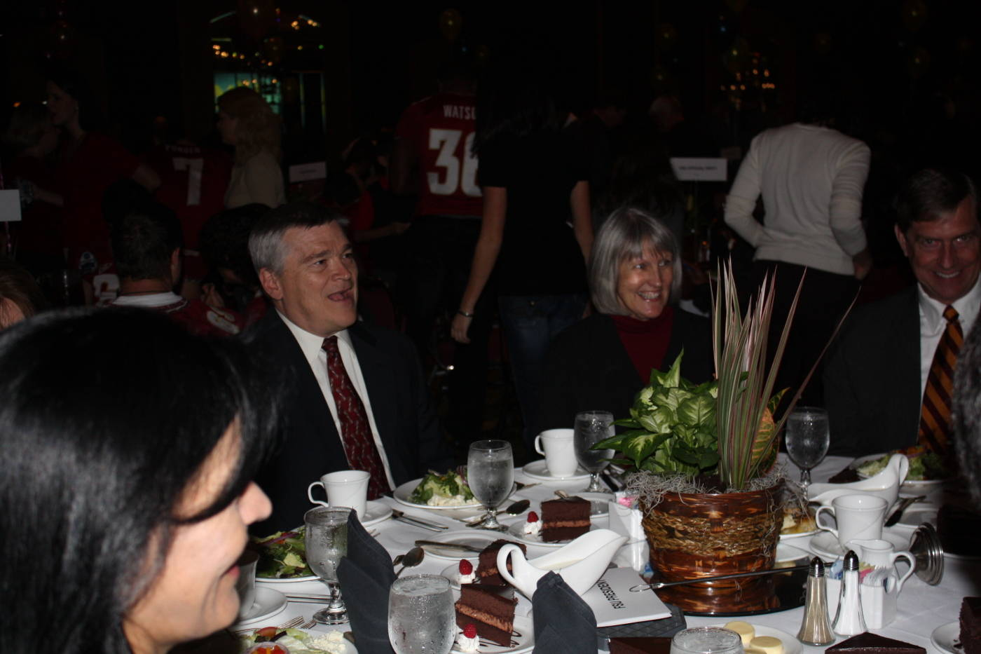 Newly appointed FSU president Dr. Eric J. Barron and wife Molly (seated to his left) at the Gator Bowl Luncheon and Hall of Fame Induction.