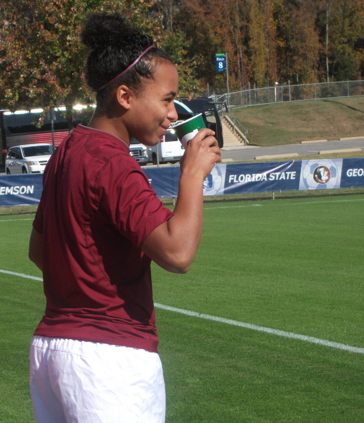 Ines Jaurena takes a quick drink during pregame warm-ups.