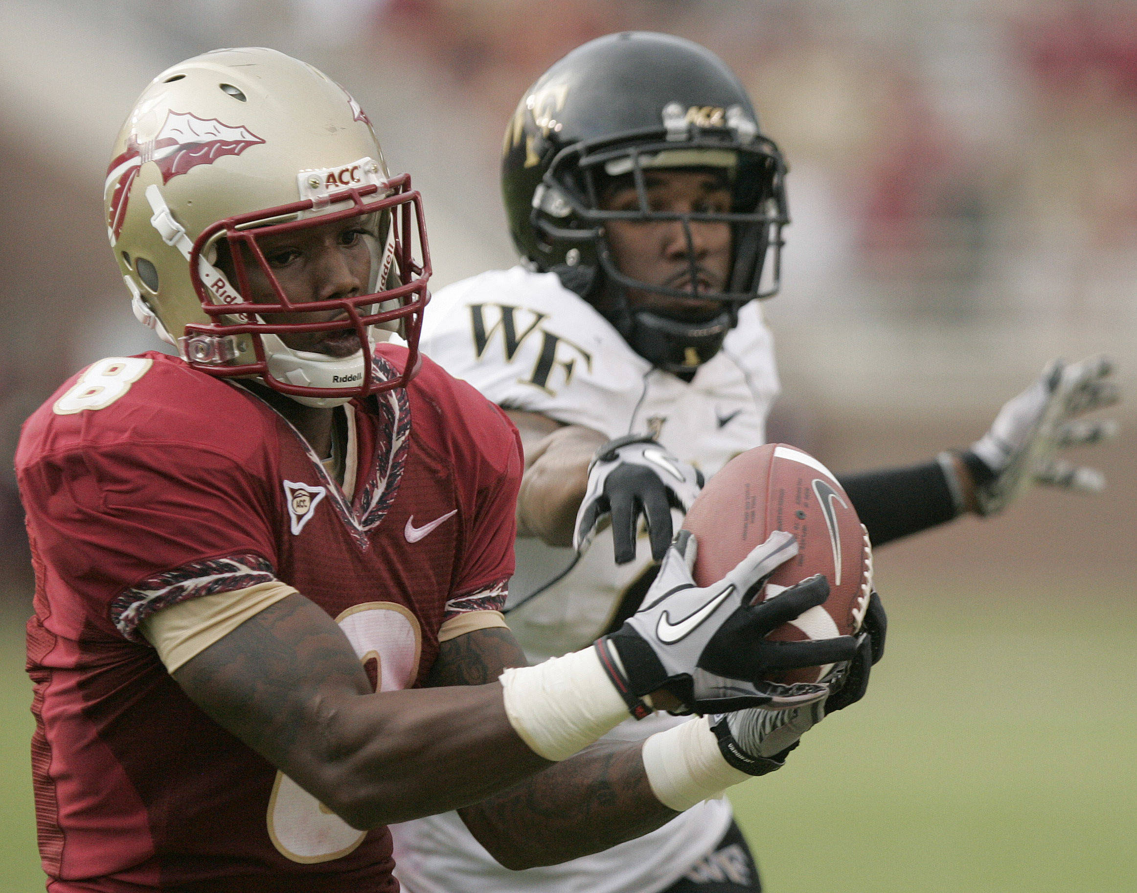 Florida State's Taiwan Easterling, left, pulls in this pass against Wake Forest's Alex Frye in the third quarter for a big gain in an NCAA college football game on Saturday, Sept. 25, 2010, in Tallahassee, Fla. (AP Photo/Steve Cannon)
