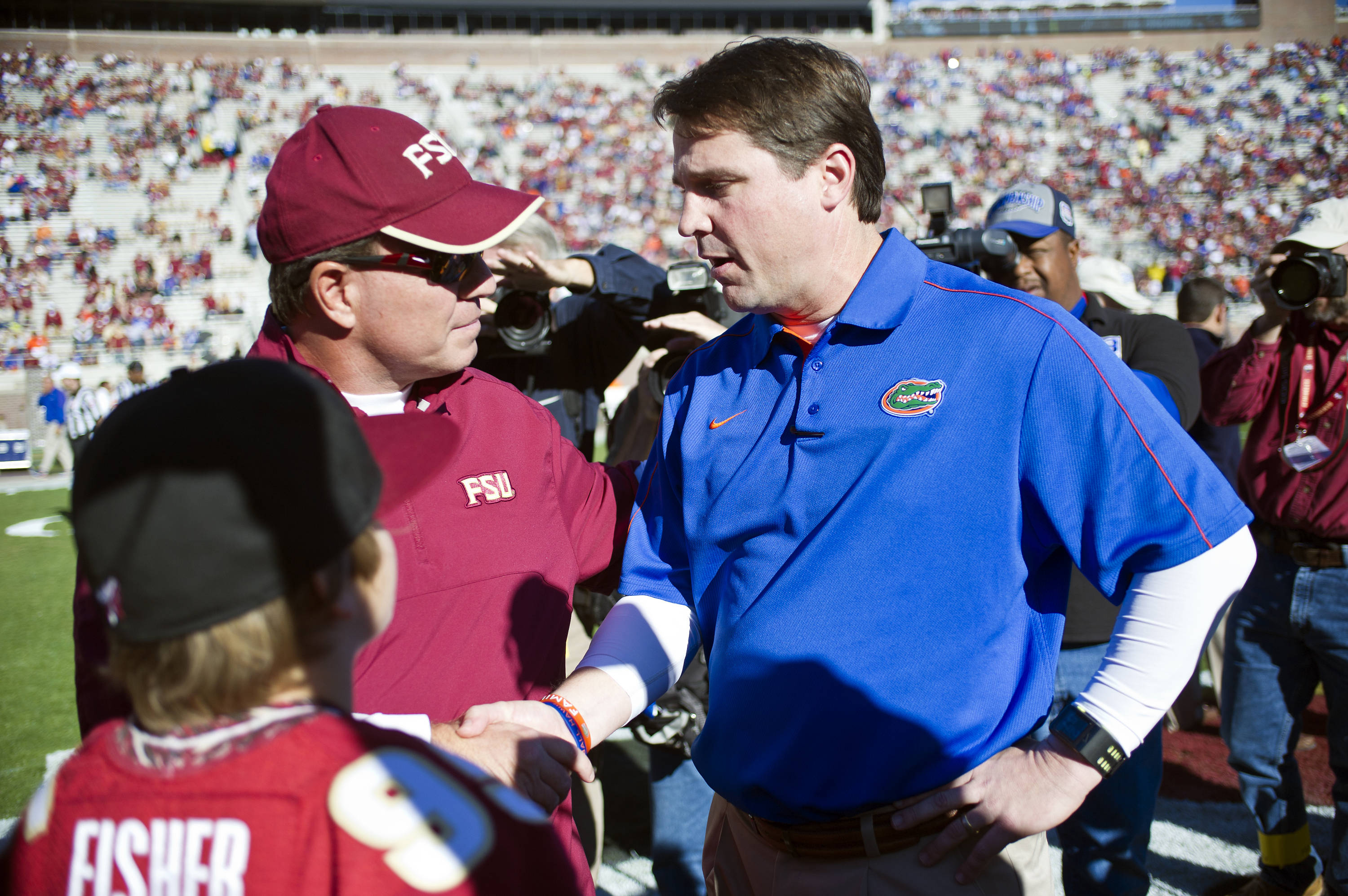 Coach Fisher and UF Coach Will Muschamp shake hands before the game