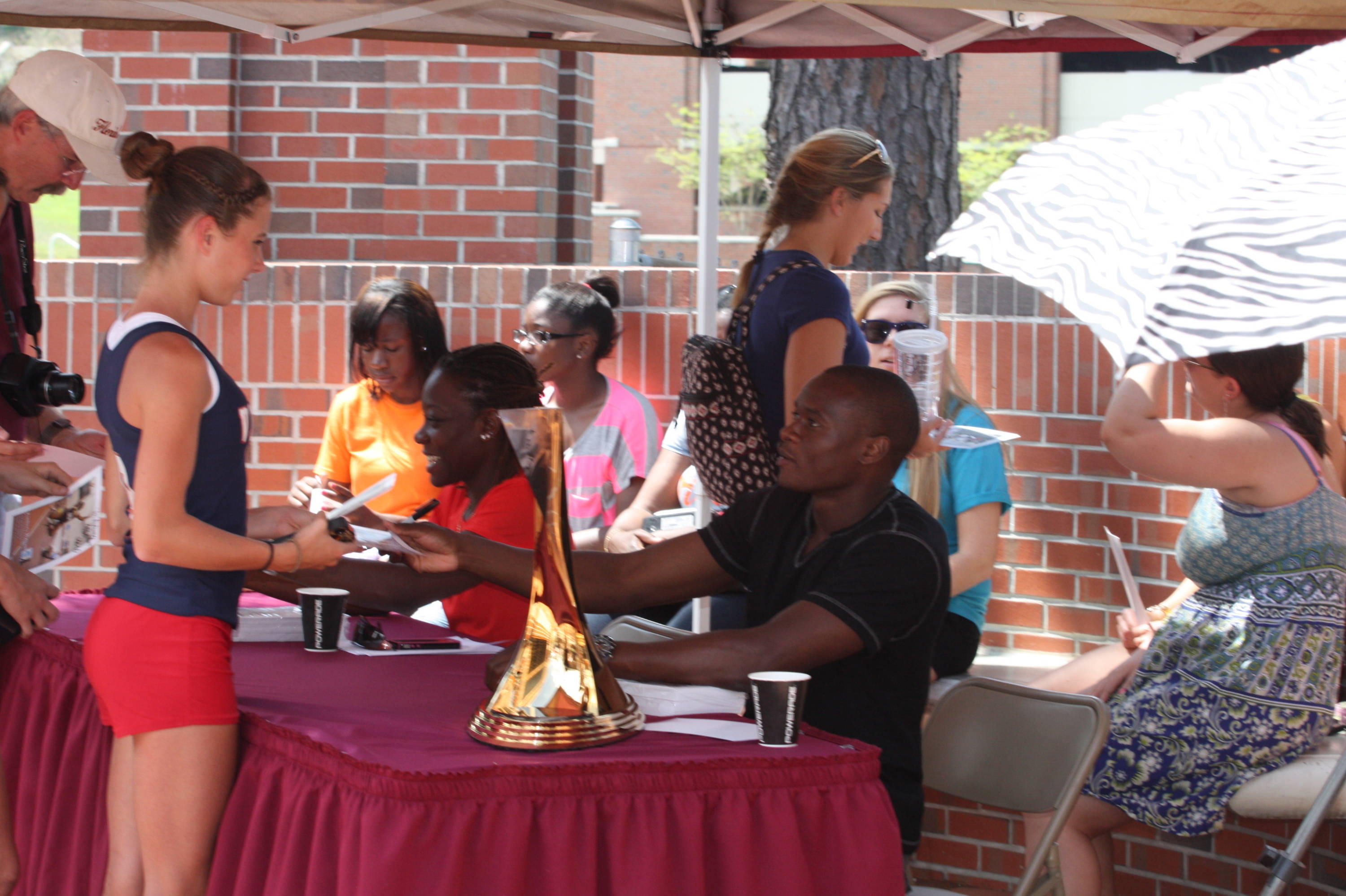 Kimberly Williams and Ngoni Makusha signed tons of autographs for young fans at TrackFest during the 2012 FSU Relays.