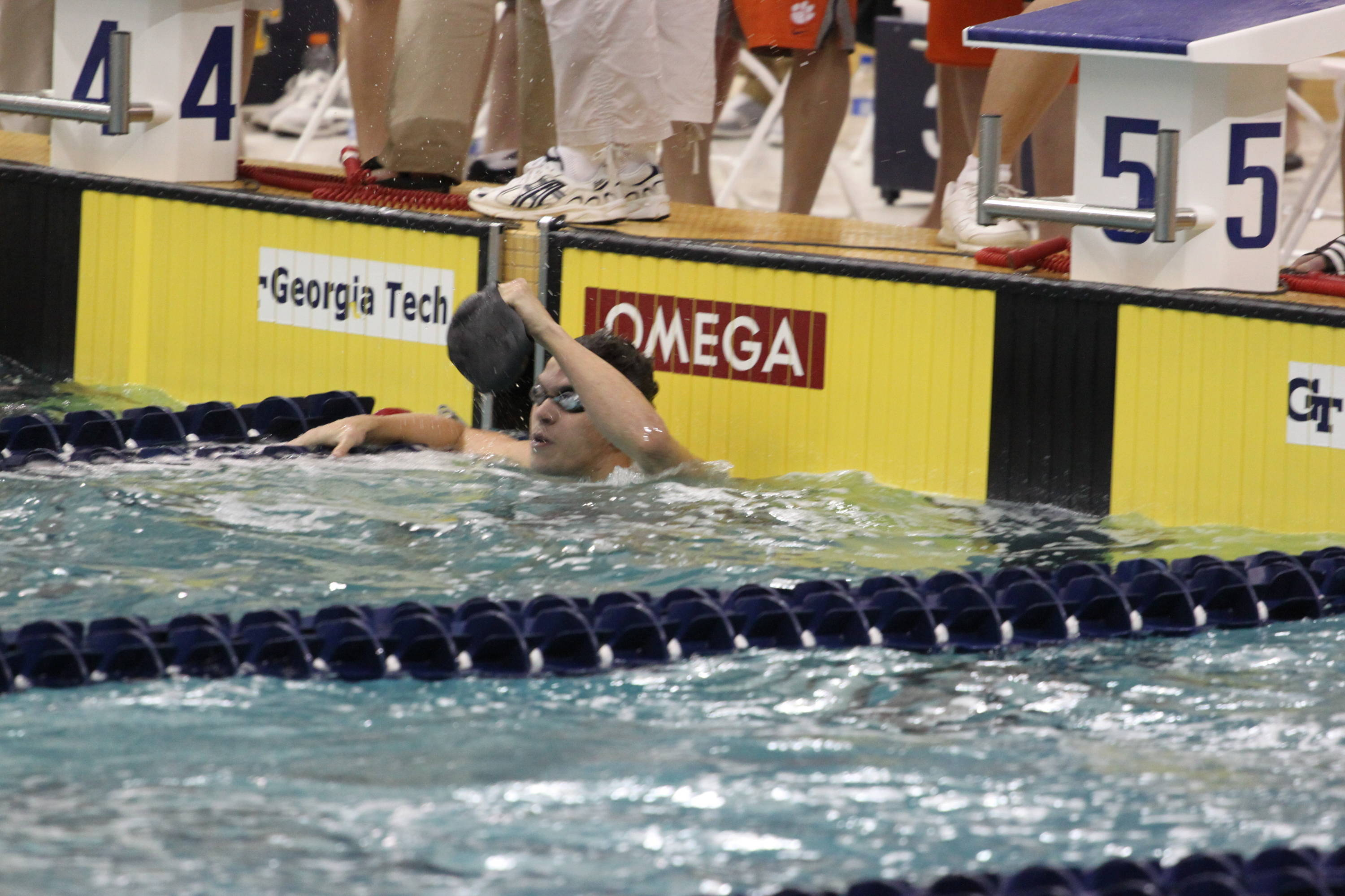Rob Holderness reacts to winning the 100 breaststroke
