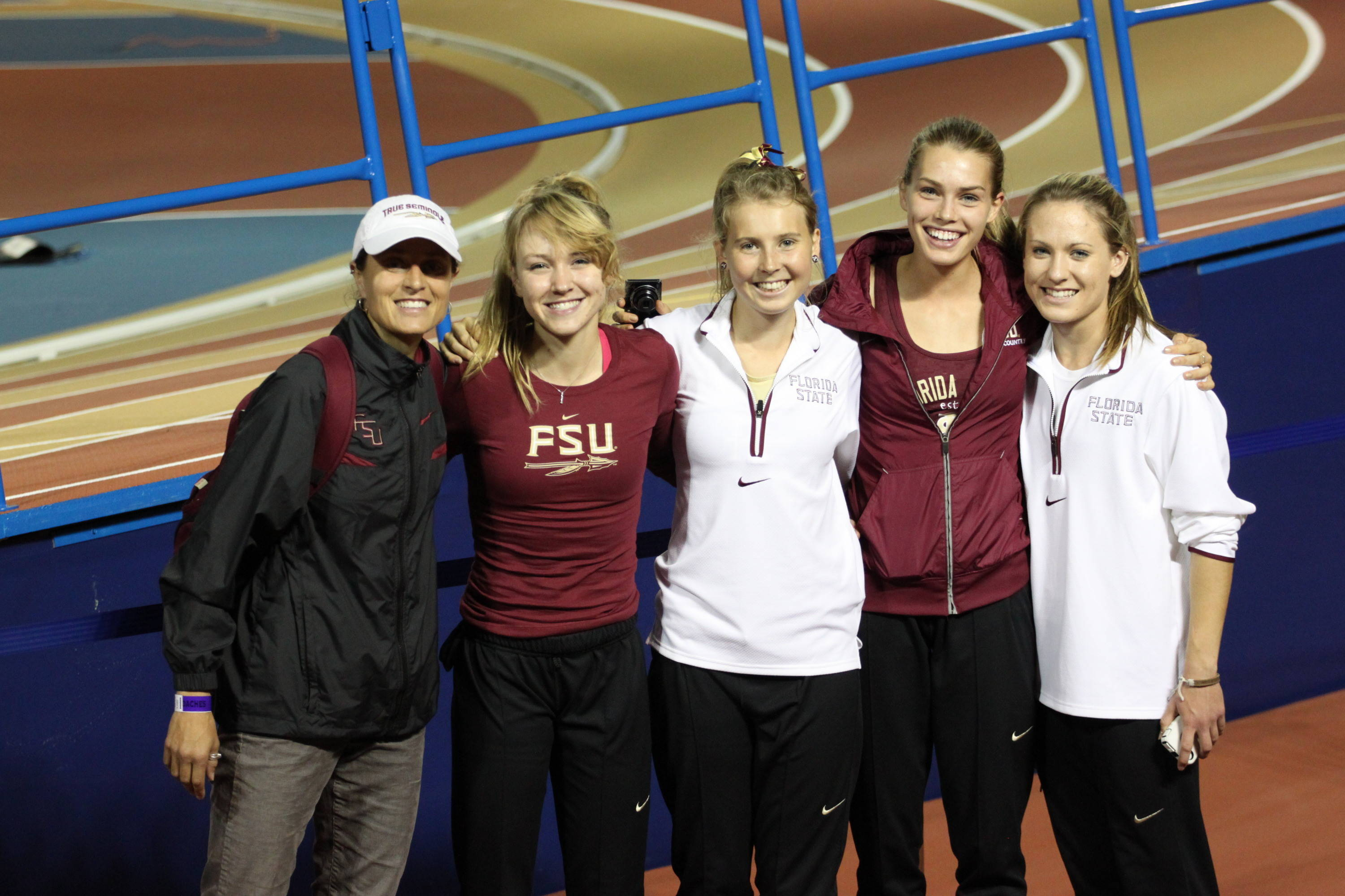 FSU women's distance coach Karen Harvey with freshmen Aubree Worden, Linden Hall, Colleen Quigley and Chelsi Woodruff after their strong showing in the mile run.
