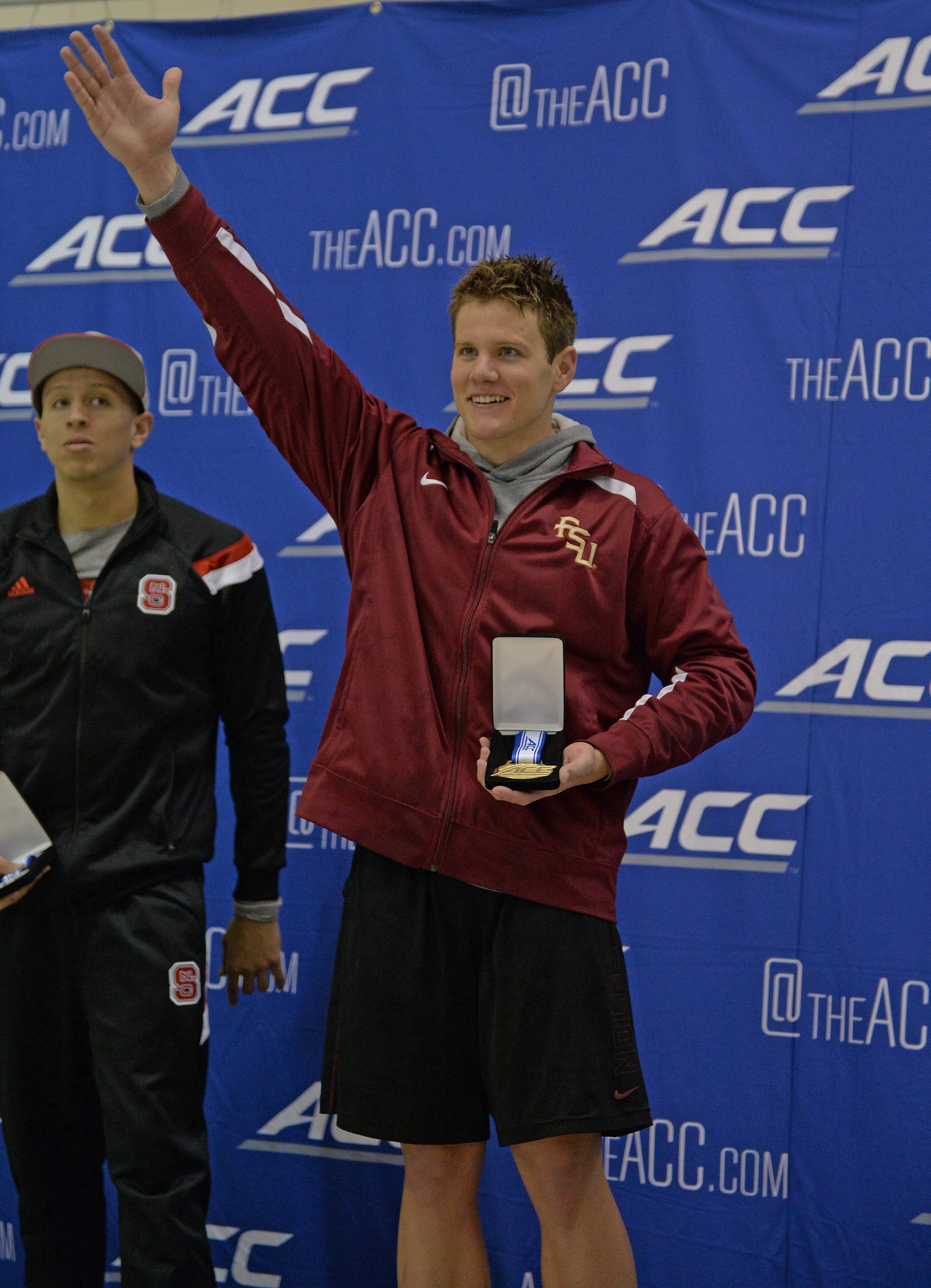 Connor Knight does the chop with the gold in the 200 fly - Mitch White