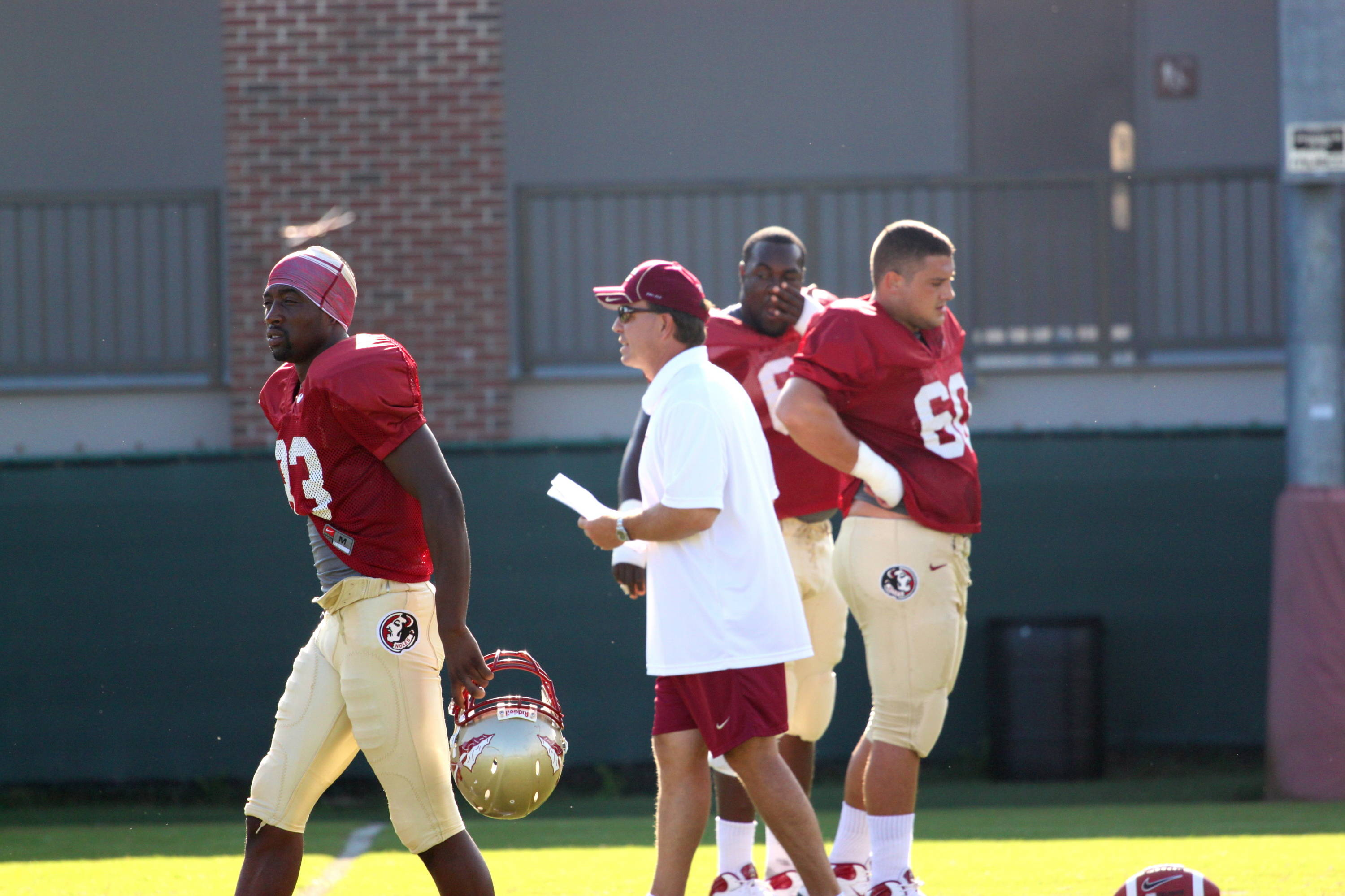 Jimbo Fisher coaches the offense during walk throughs