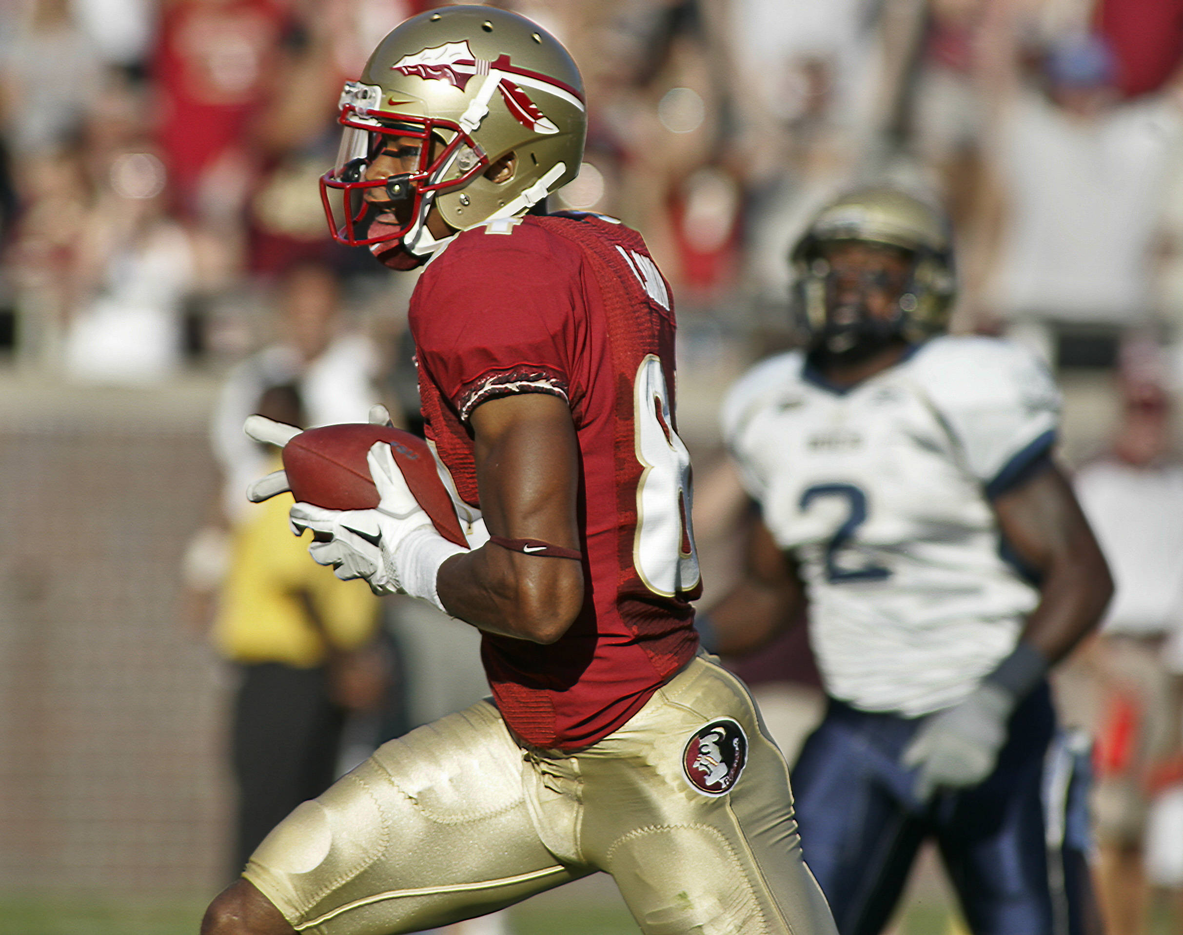 Florida State wide receiver Rodney Smith (84) scores a touchdown on a 45-yard pass as Charleston Southern defensive back O'Brian Campbell (2) can't catch him in the first quarter of an NCAA college football game on Saturday, Sept. 10, 2011, in Tallahassee, Fla. (AP Photo/Phil Sears)