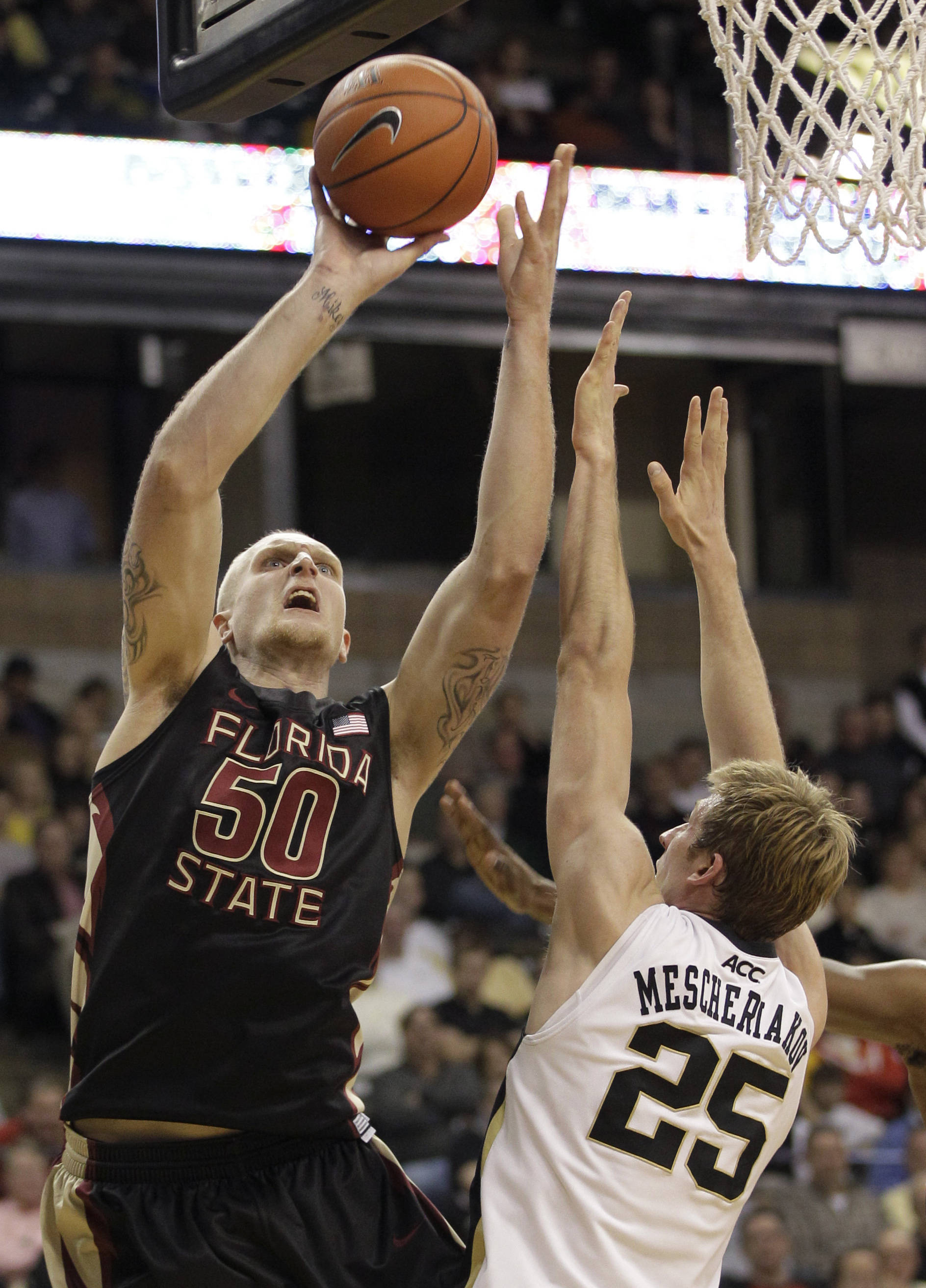 Florida State's Jon Kreft shoots over Wake Forest's Nikita Mescheriakov. (AP Photo/Chuck Burton)