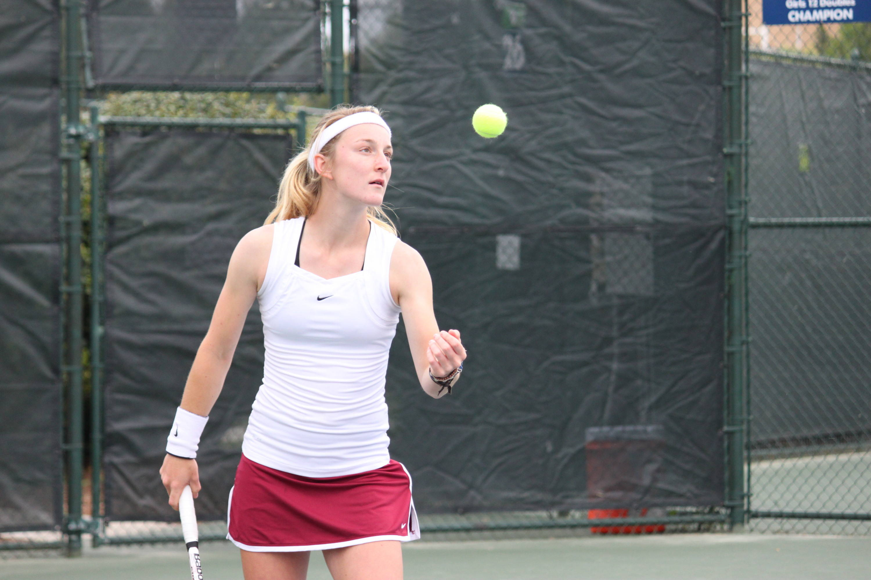 Ruth Seaborne tossing the ball as she gets ready to serve.