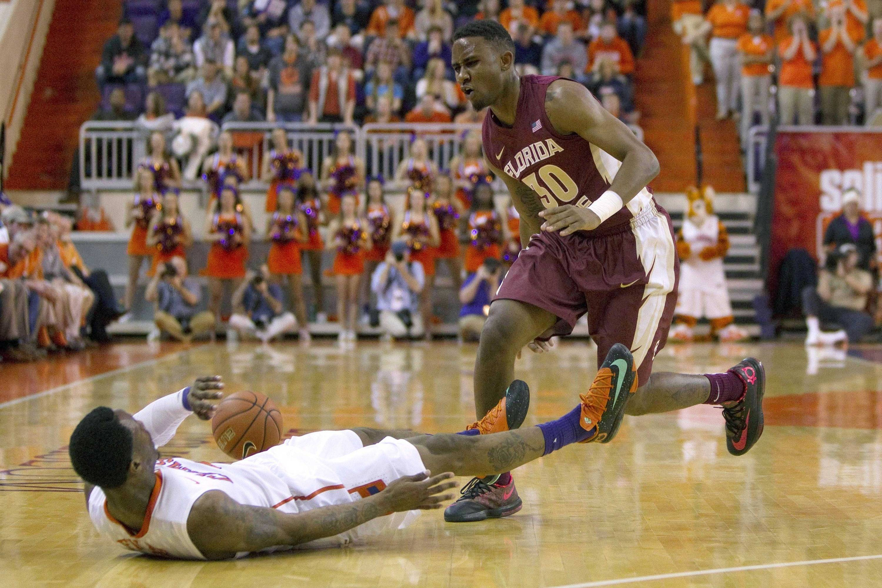 Jan 9, 2014; Clemson, SC, USA; Clemson Tigers guard Adonis Filer (3) is knocked down by Florida State Seminoles guard Ian Miller (30) during the first half at J.C. Littlejohn Coliseum. Mandatory Credit: Joshua S. Kelly-USA TODAY Sports