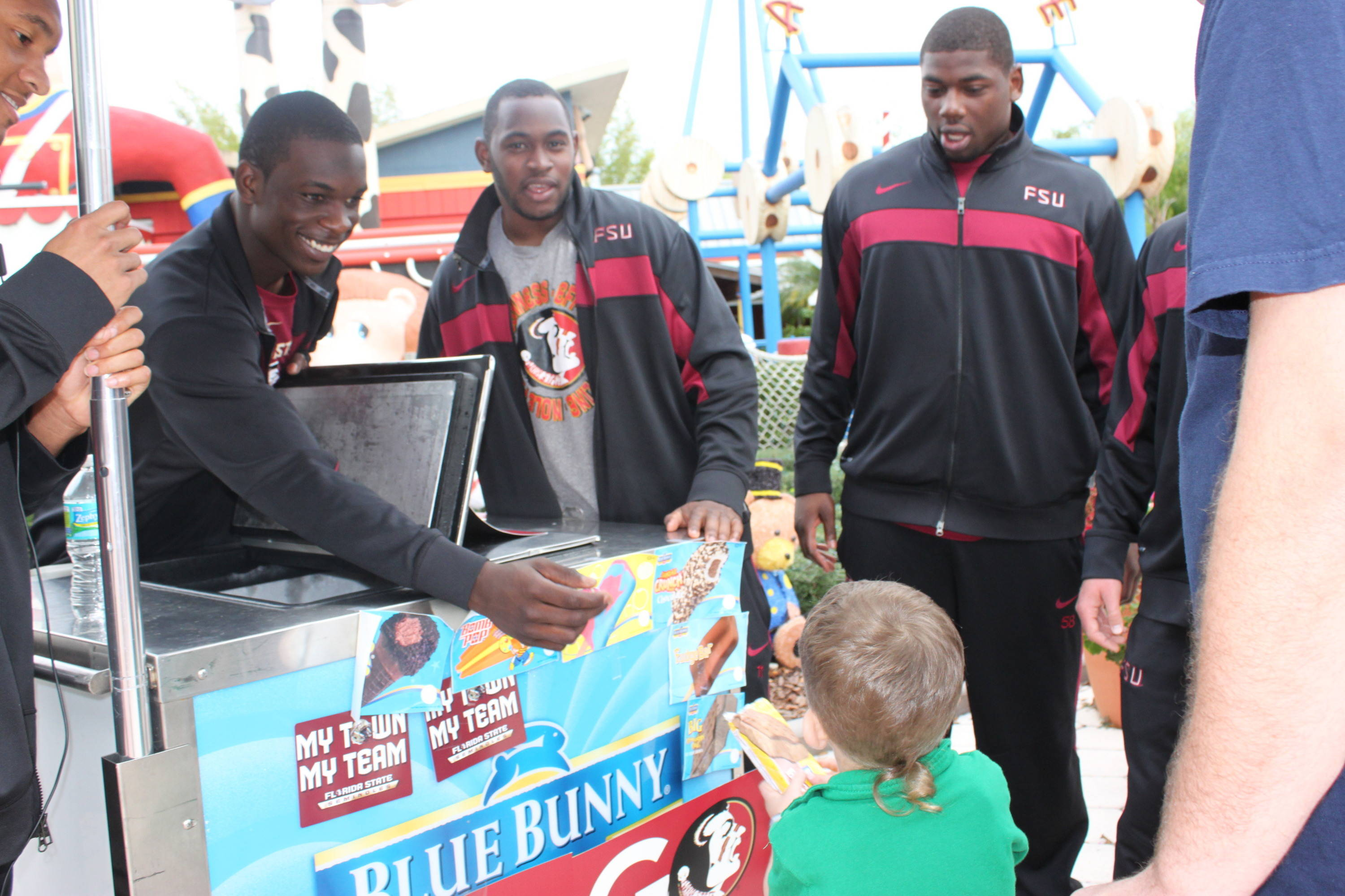 Telvin Smith, Vince Williams and Dan Hicks know the Ice Cream man is always a favorite with kids.