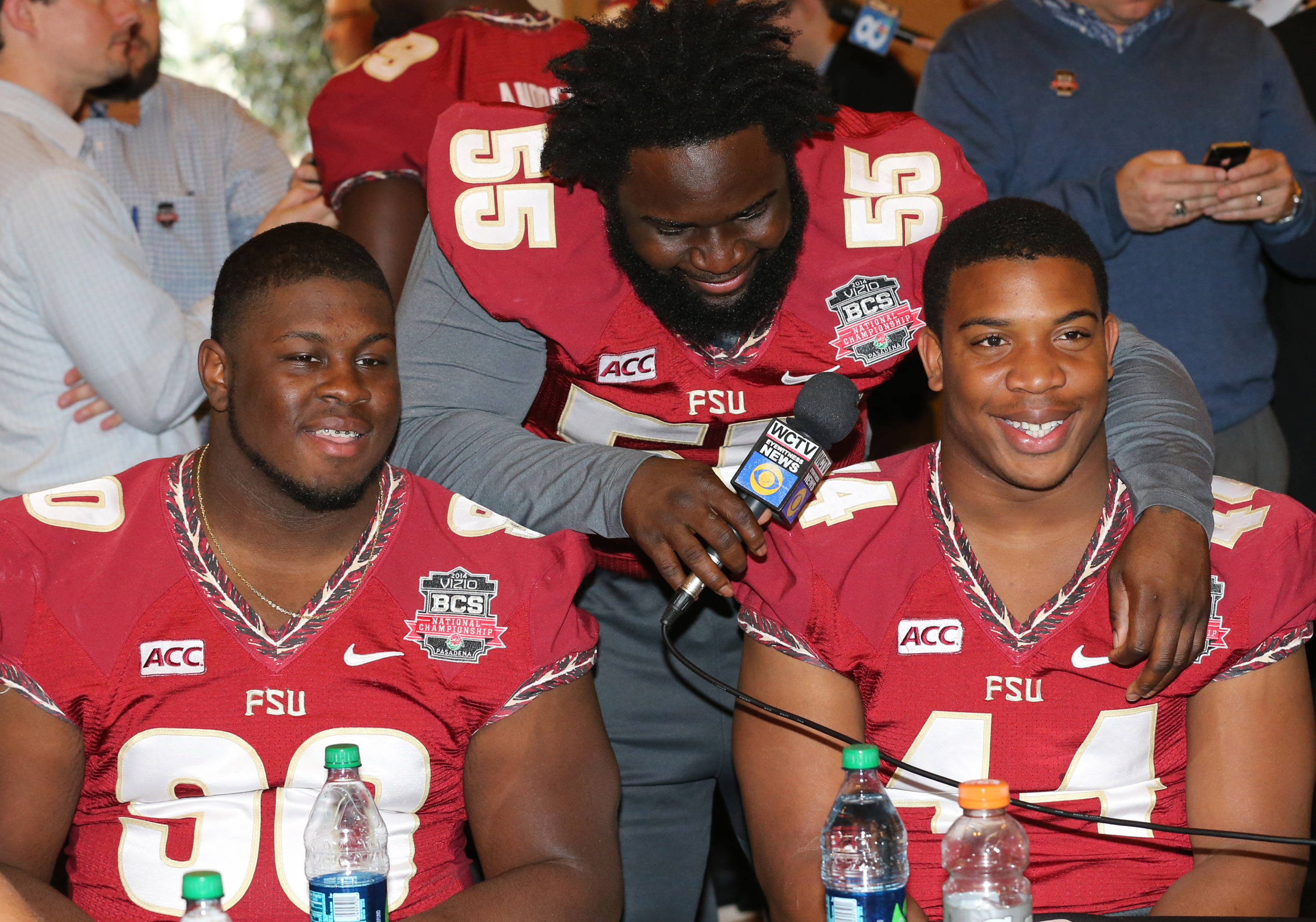 Jan 4, 2014; Newport Beach, CA, USA; Seminoles lineman Ira Denson (55) interviews his teammates defensive tackle Eddie Goldman (90) and defensive end DeMarcus Walker (44) during Media Day at Newport Beach Marriott. Matthew Emmons-USA TODAY Sports