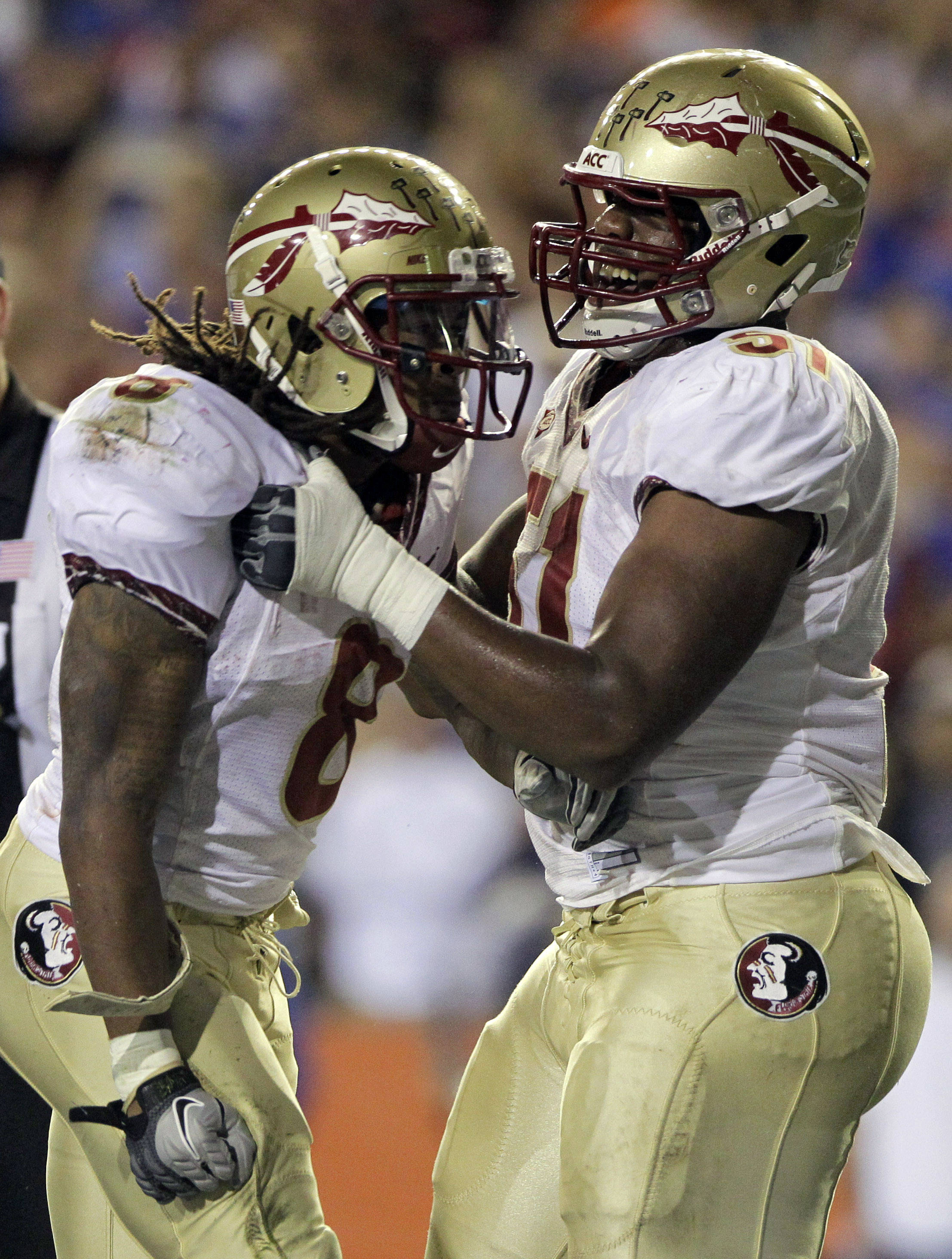 Florida State running back Devonta Freeman, left, celebrates with teammate offensive linesman Bobby Hart after a one-yard touchdown run against Florida during the first half of an NCAA college football game on Saturday, Nov. 26, 2011, in Gainesville, Fla. (AP Photo/John Raoux)