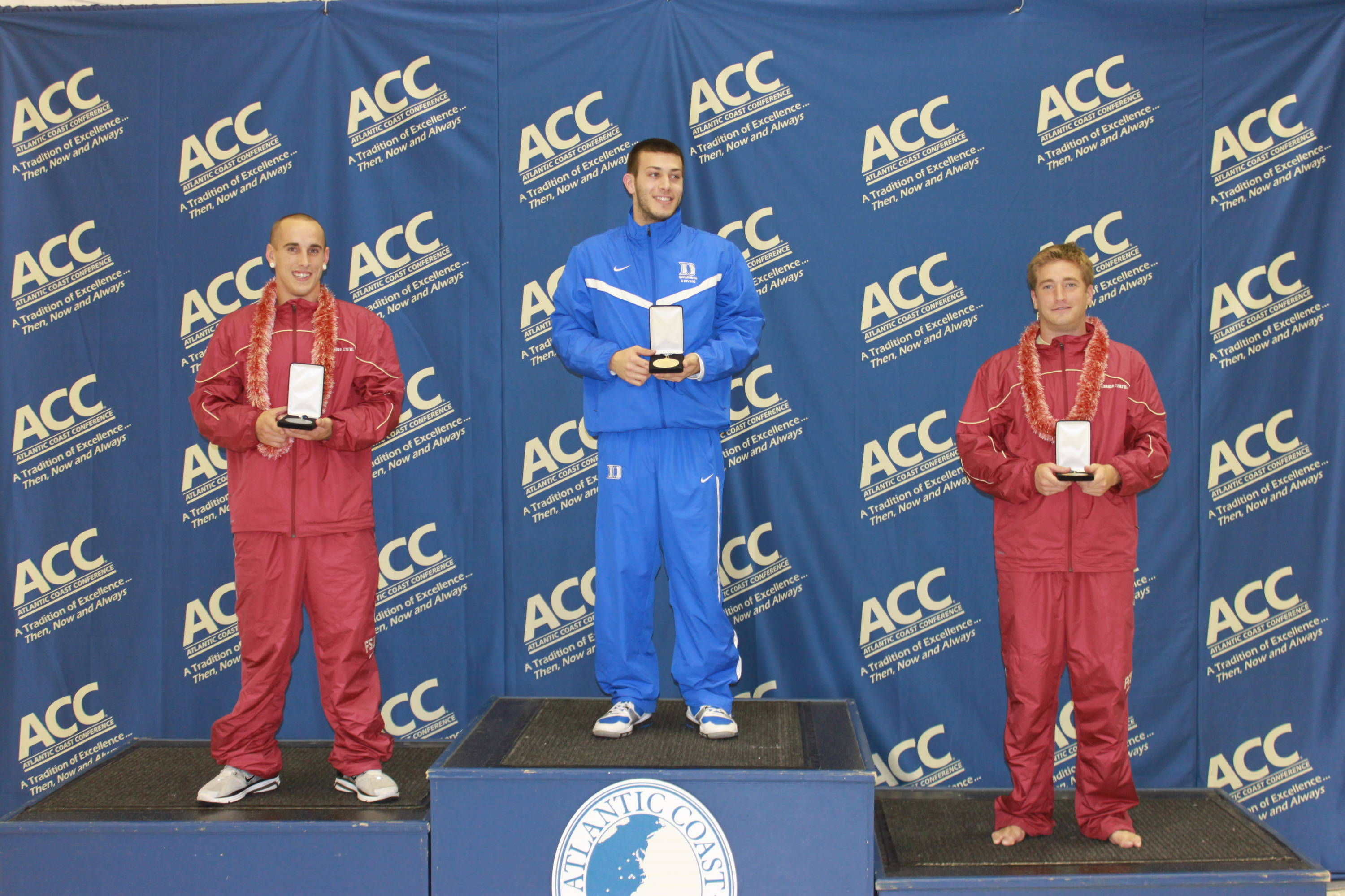 Landon Marzullo and Jordan Horsley on the podium after the men's one-meter