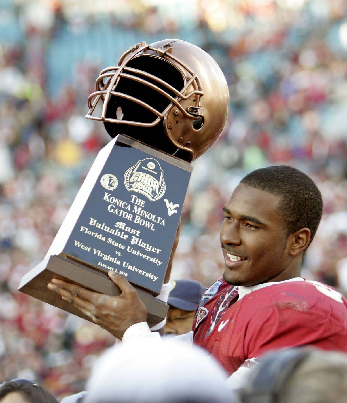 Florida State quarterback E.J. Manuel holds up the Most Valuable Player trophy following the Seminoles 33-21 win over West Virginia in the Gator Bowl NCAA college football game, Friday, Jan. 1, 2010, in Jacksonville, Fla. (AP Photo/Phil Coale)