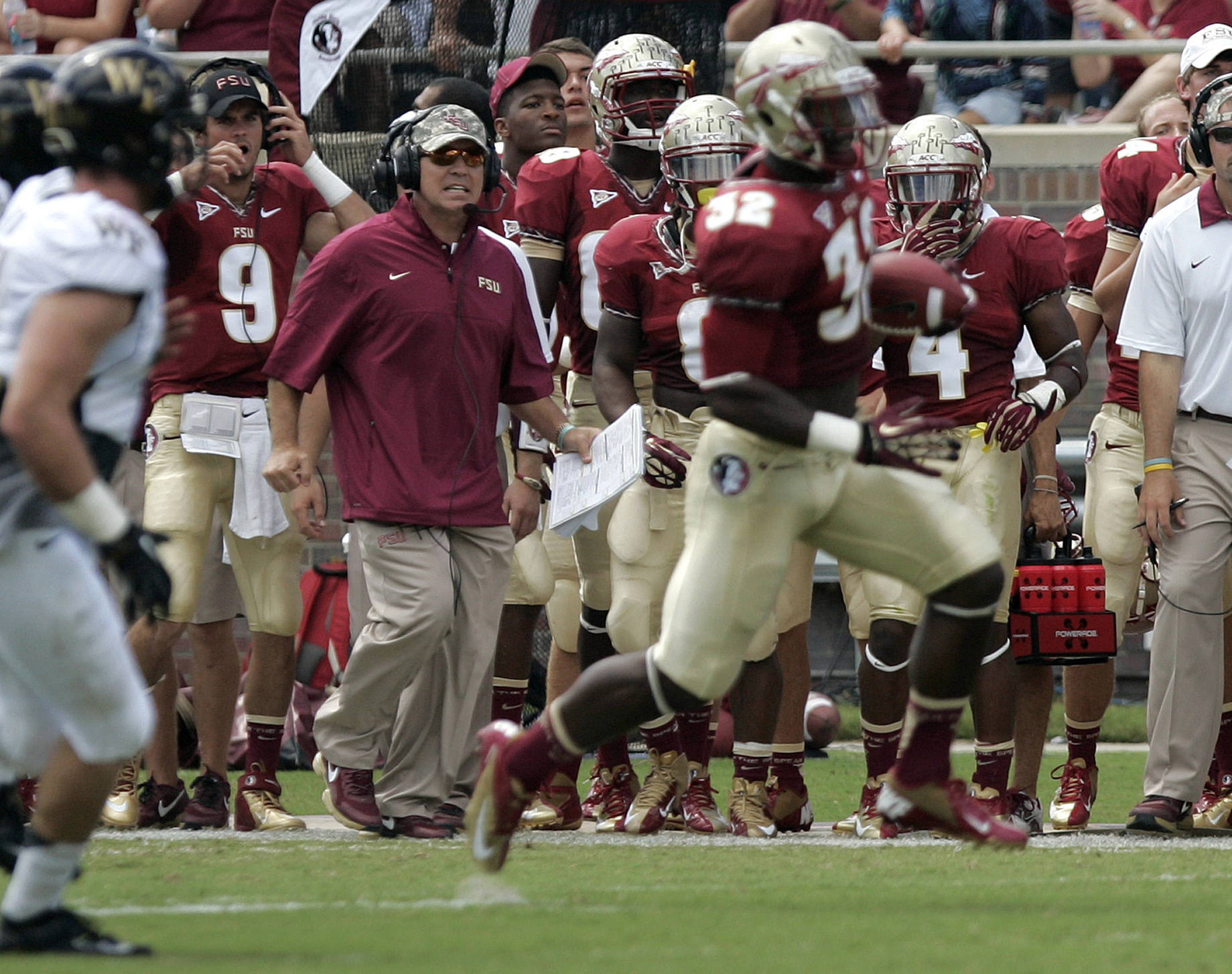 Florida State's head coach Jimbo Fisher, third from left, watches his running back James Wilder Jr. pickup a first downa. (AP Photo/Steve Cannon)