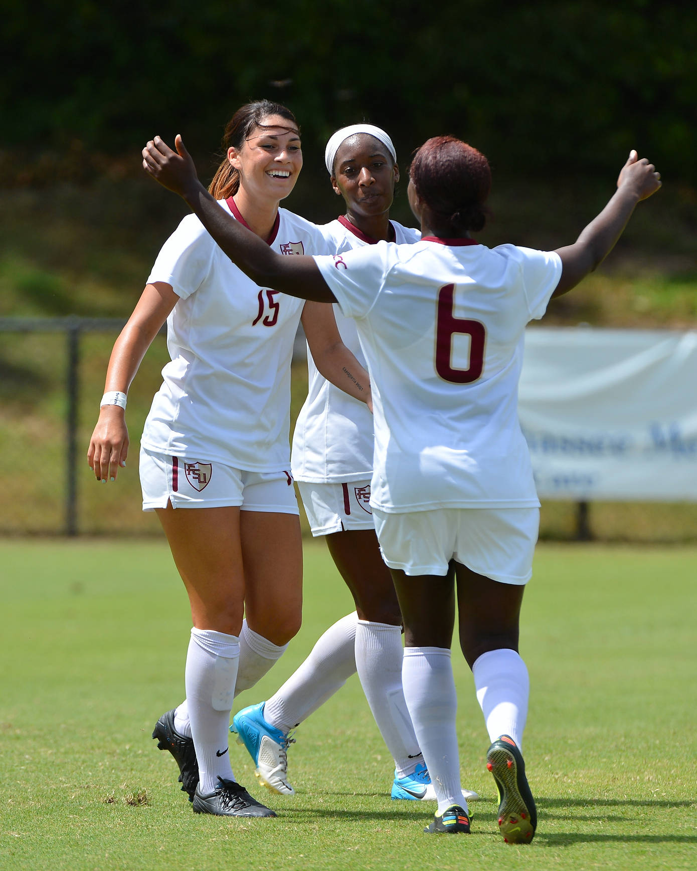 The Seminoles celebrate following Tiana's goal against Wake Forest.