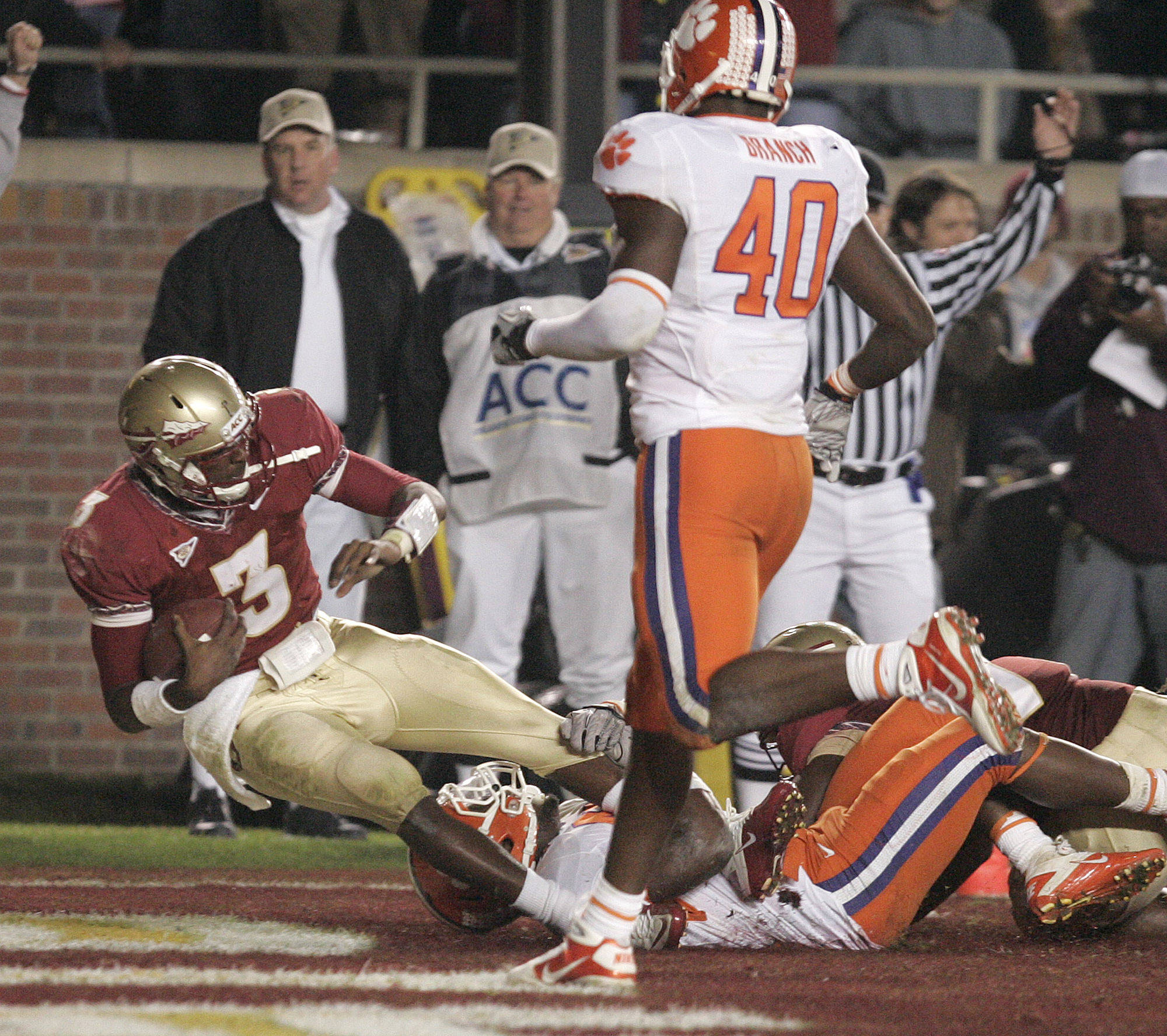 Dragging a Clemson defender Florida State's EJ Manuel scores in the fourth quarter of an NCAA college football game on Saturday, Nov. 13, 2010 in Tallahassee, Fla.(AP Photo/Steve Cannon)