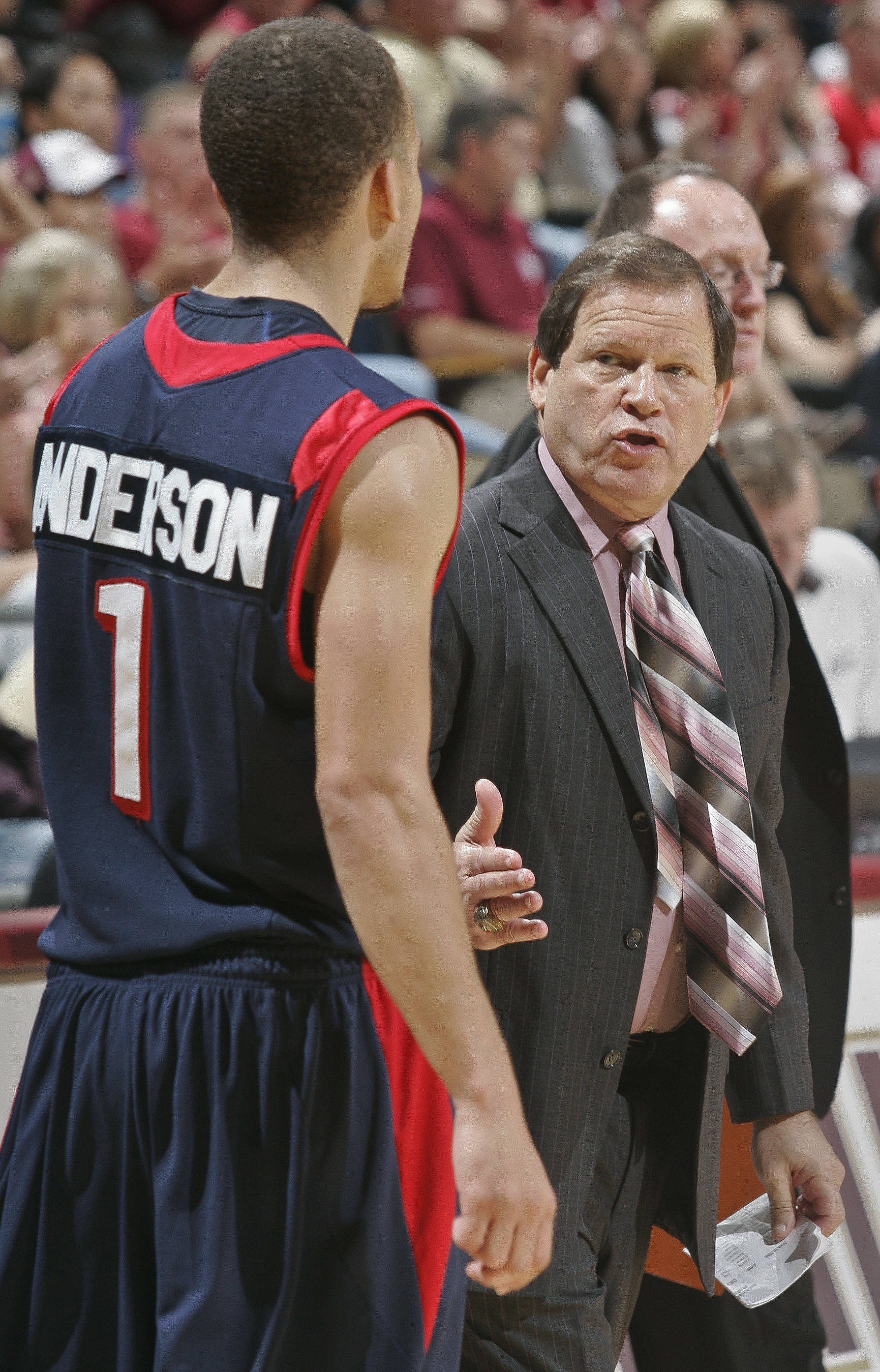 South Alabama head coach Ronnie Arrow, right, talks to guard Trey Anderson (1) at the end of the first half against Florida State. (AP Photo/Phil Sears)