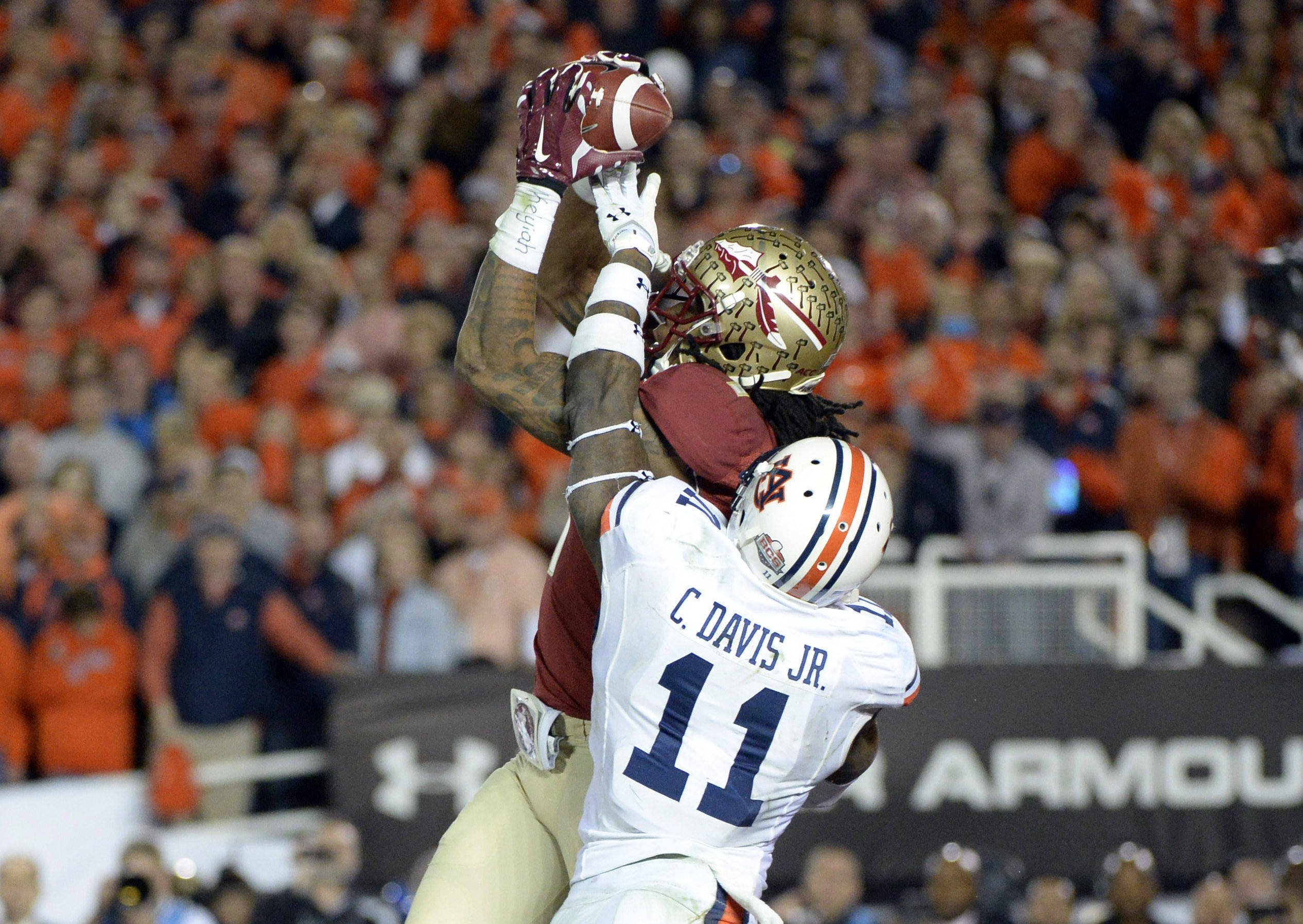 Jan 6, 2014; Pasadena, CA, USA; Florida State Seminoles wide receiver Kelvin Benjamin (1) catches a pass for a touchdown as Auburn Tigers cornerback Chris Davis (11) tackles during the second half of the 2014 BCS National Championship game at the Rose Bowl.  Mandatory Credit: Richard Mackson-USA TODAY Sports