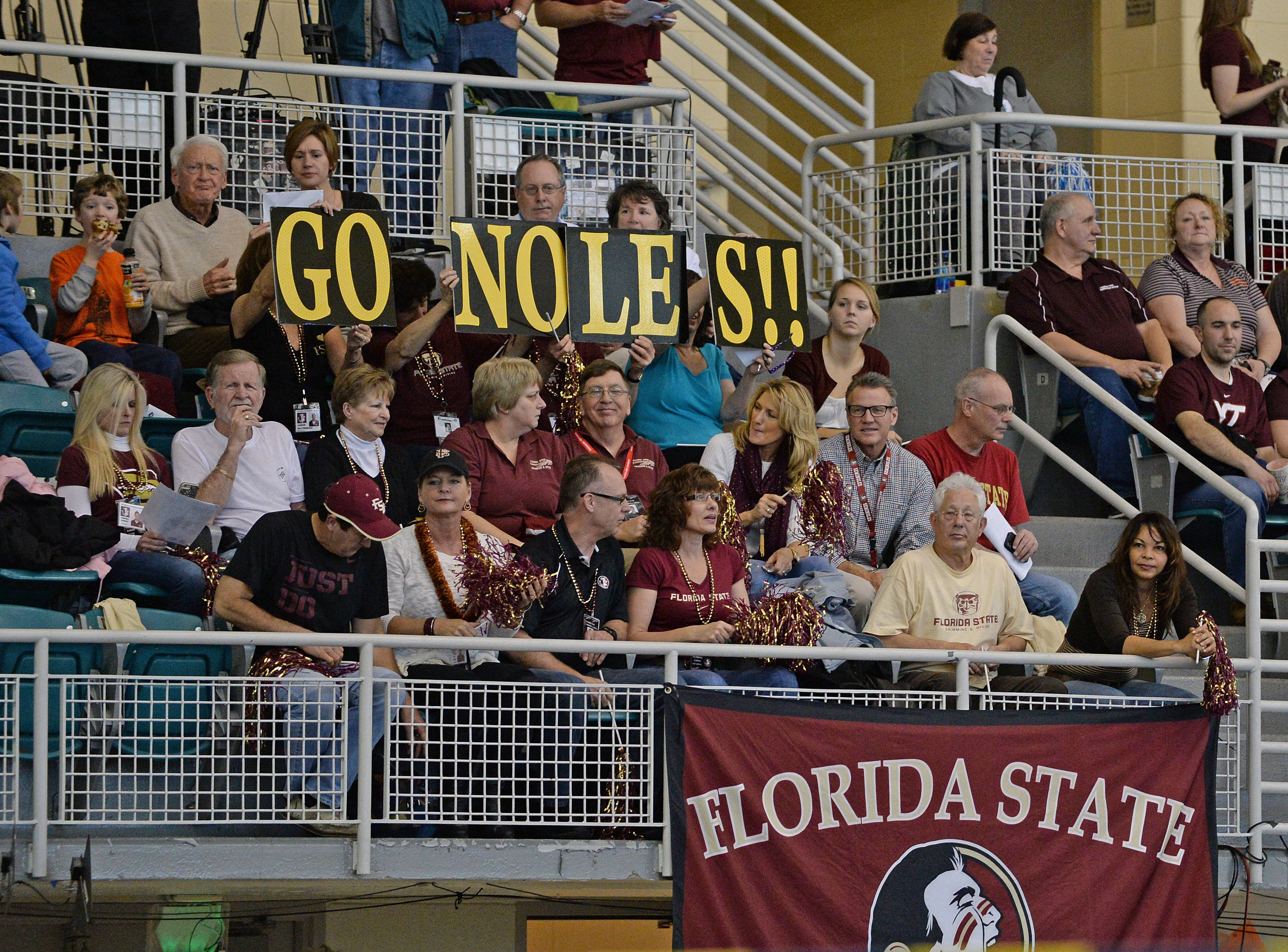 The parents cheer on their swimmers - Mitch White
