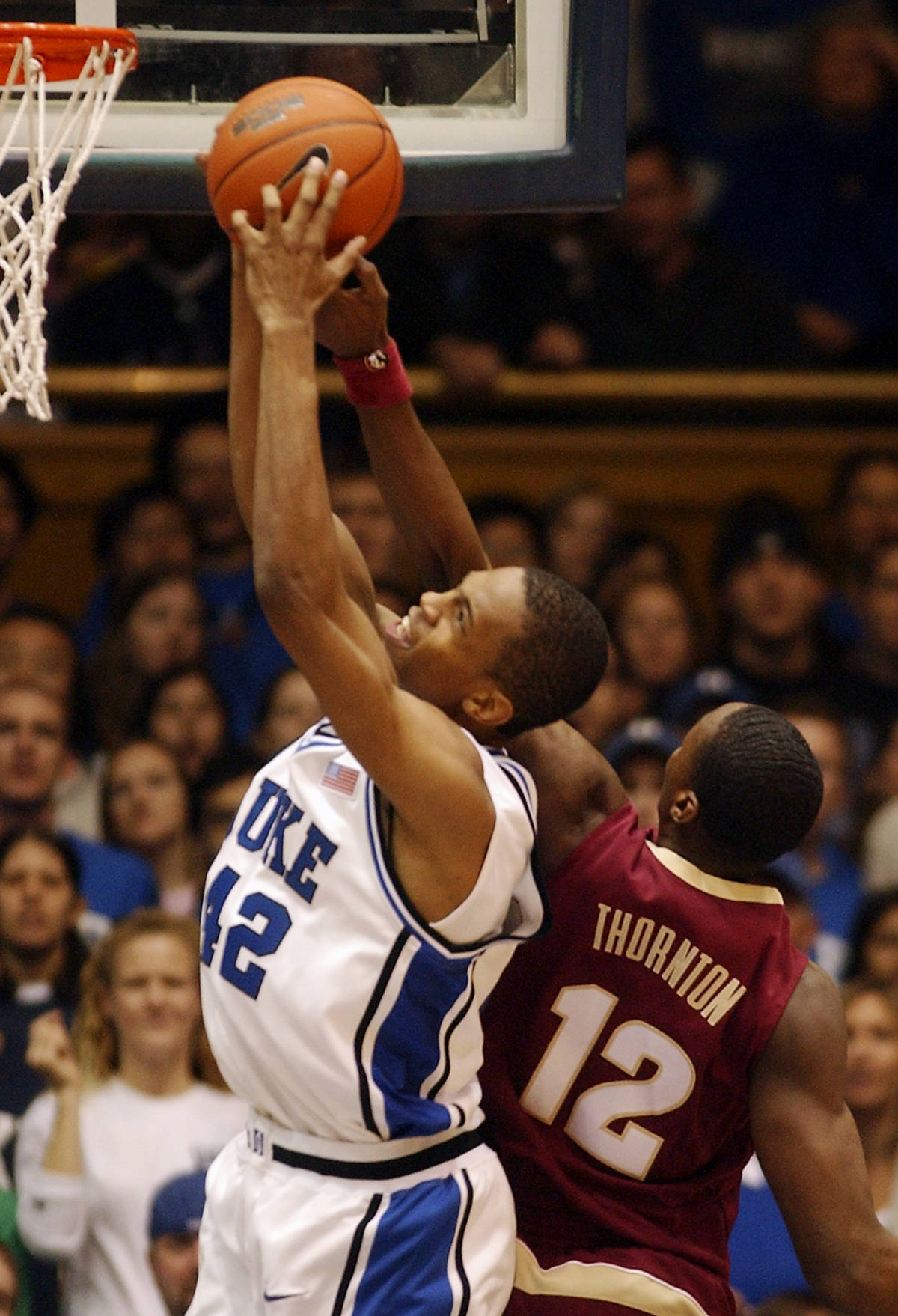 Duke's Lance Thomas (42) pulls down a rebound over Florida State's Al Thornton (12) in the first half of a basketball game in Durham, N.C., on Sunday, Feb. 4, 2007. (AP Photo/Sara D. Davis)