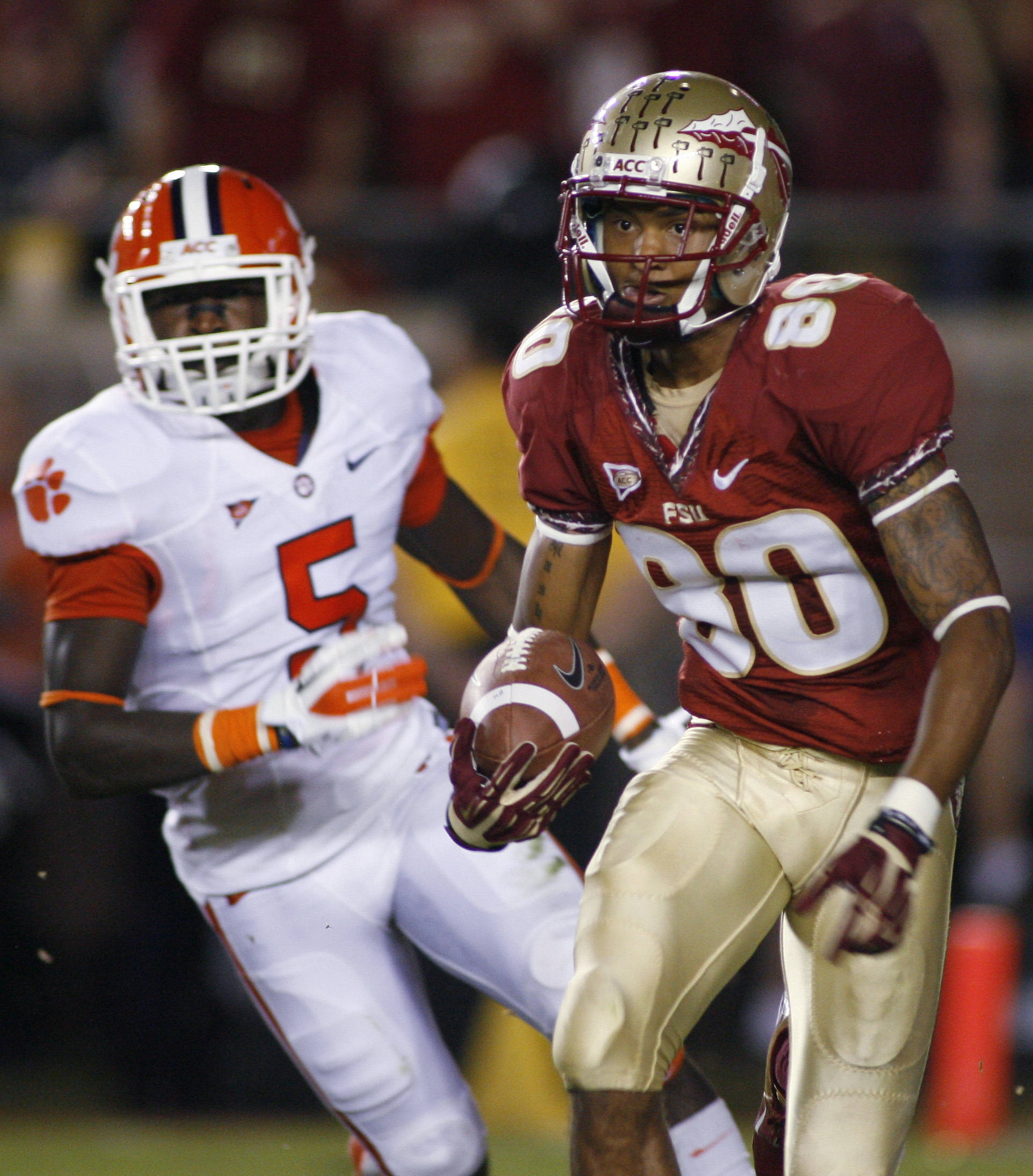 Florida State wide receiver Rashad Greene (80) returns a punt for 30 yards past Clemson safety Jonathan Meeks (5). (AP Photo/Phil Sears)