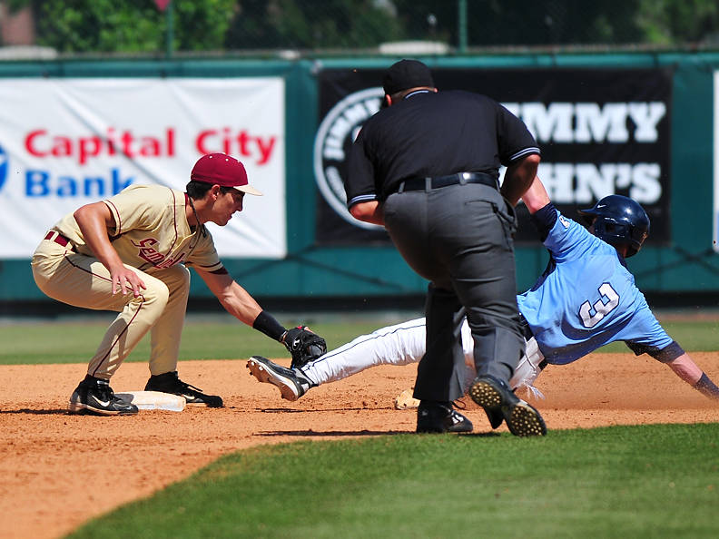Shortstop Justin Gonzalez applies the tag and retires another would-be UNC base-stealer. Catcher Rafael Lopez gunned down three Tar Heels Sunday.