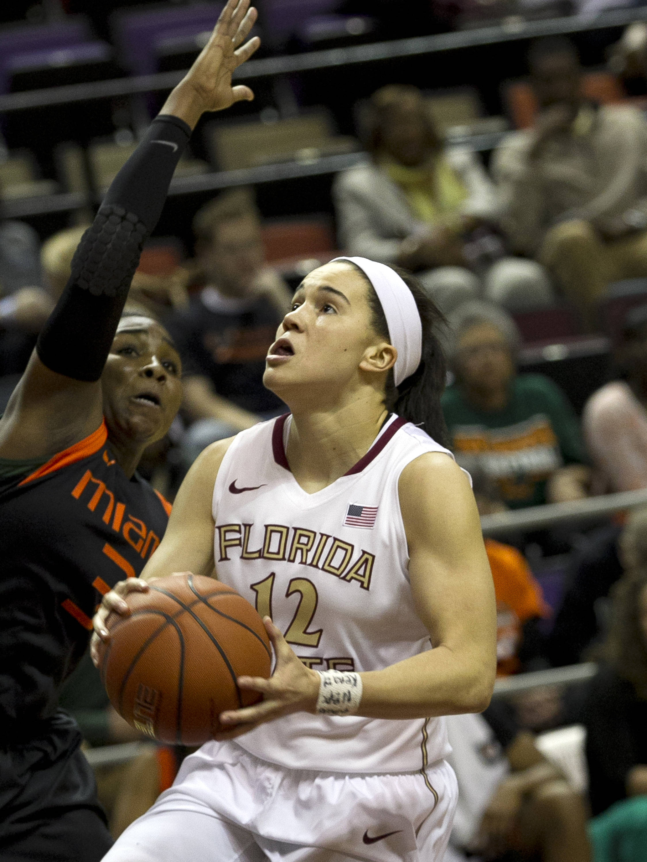 Brittany Brown (12) about to be fouled on a fast break, FSU vs Miami, 2-16-14, (Photo's by Steve Musco)