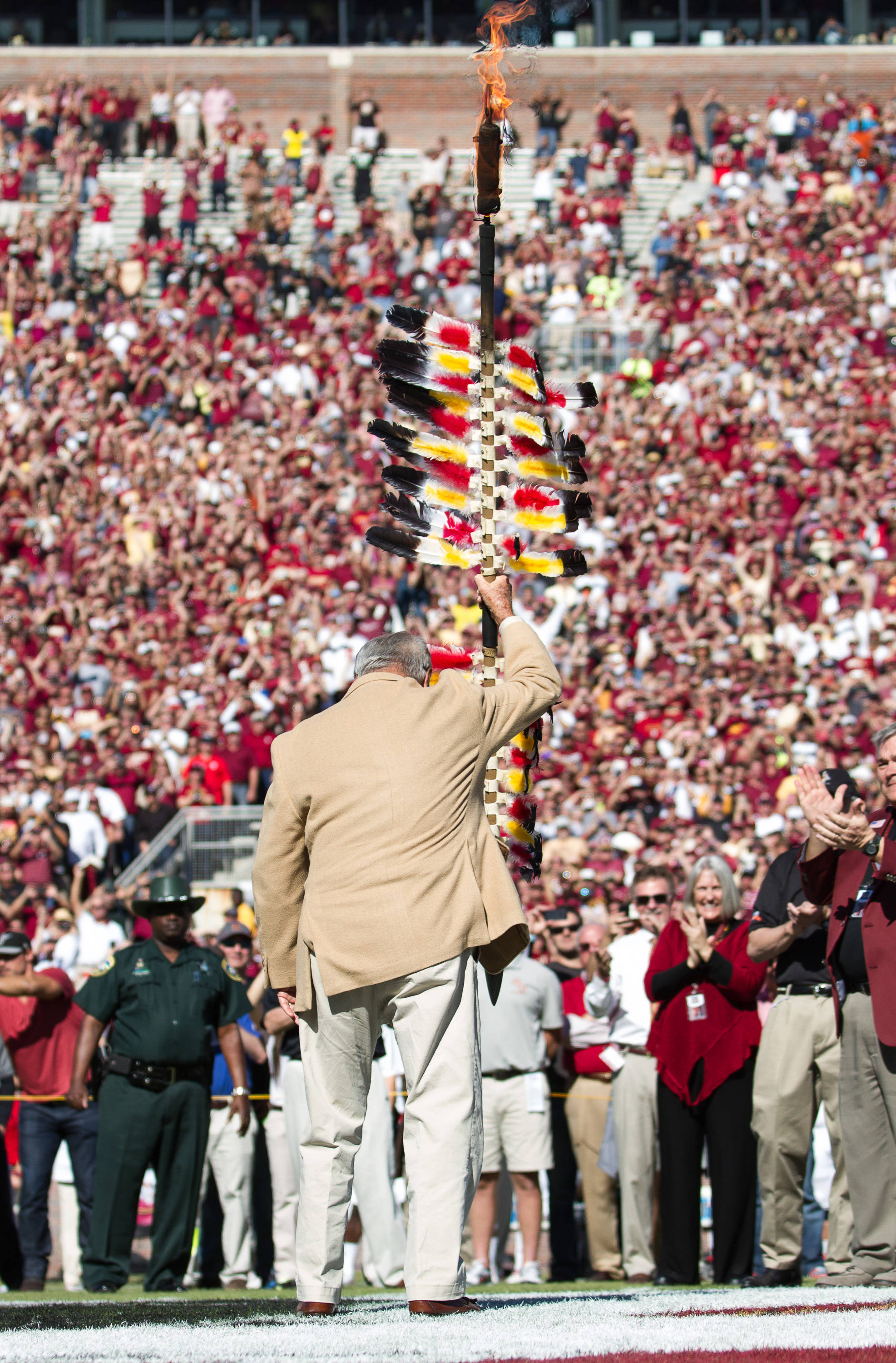 Bobby Bowden plants the spear before FSU Football's 49-17 win over NC State on Saturday, October 26, 2013 in Tallahassee, Fla. Photo by Michael Schwarz.