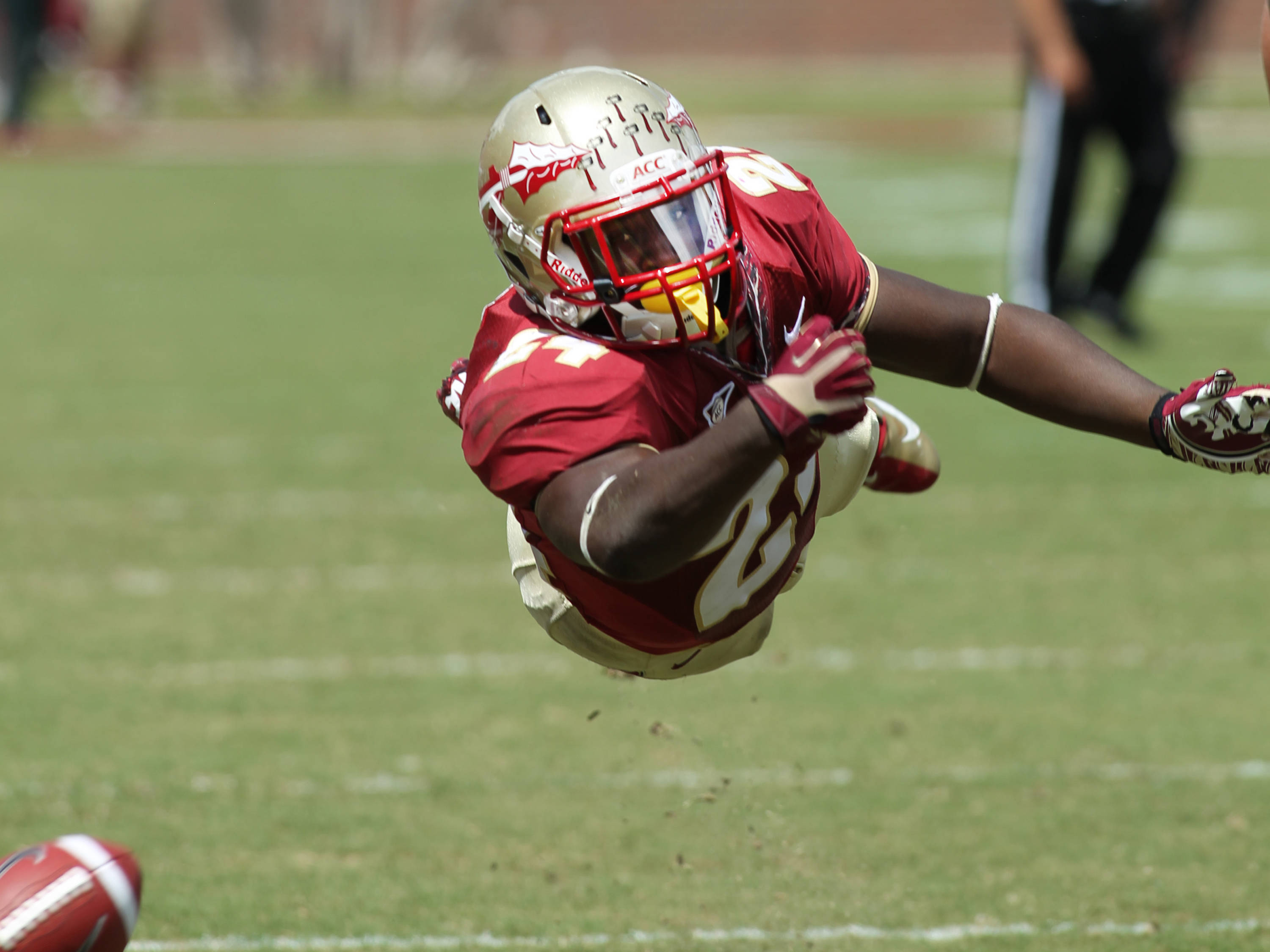 Lonnie Pryor (24) reaching for a pass, FSU vs Wake Forest, 9/15/12 (Photo by Steve Musco)