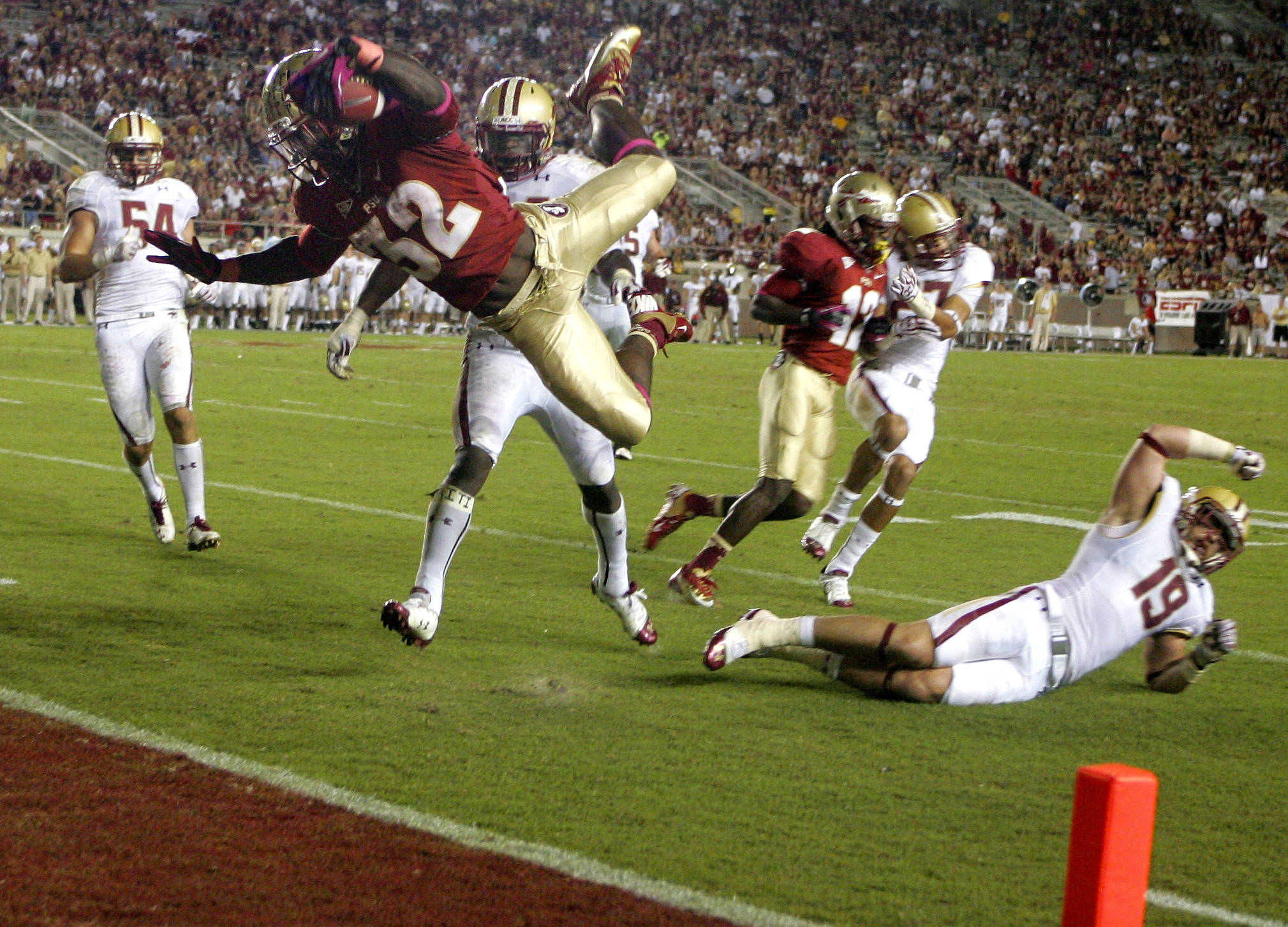 Florida State running back James Wilder Jr. (32) flies over Boston College defensive back Sean Sylvia (19) into the end zone with a 12-yard pass reception in the fourth quarter. (AP Photo/Phil Sears)