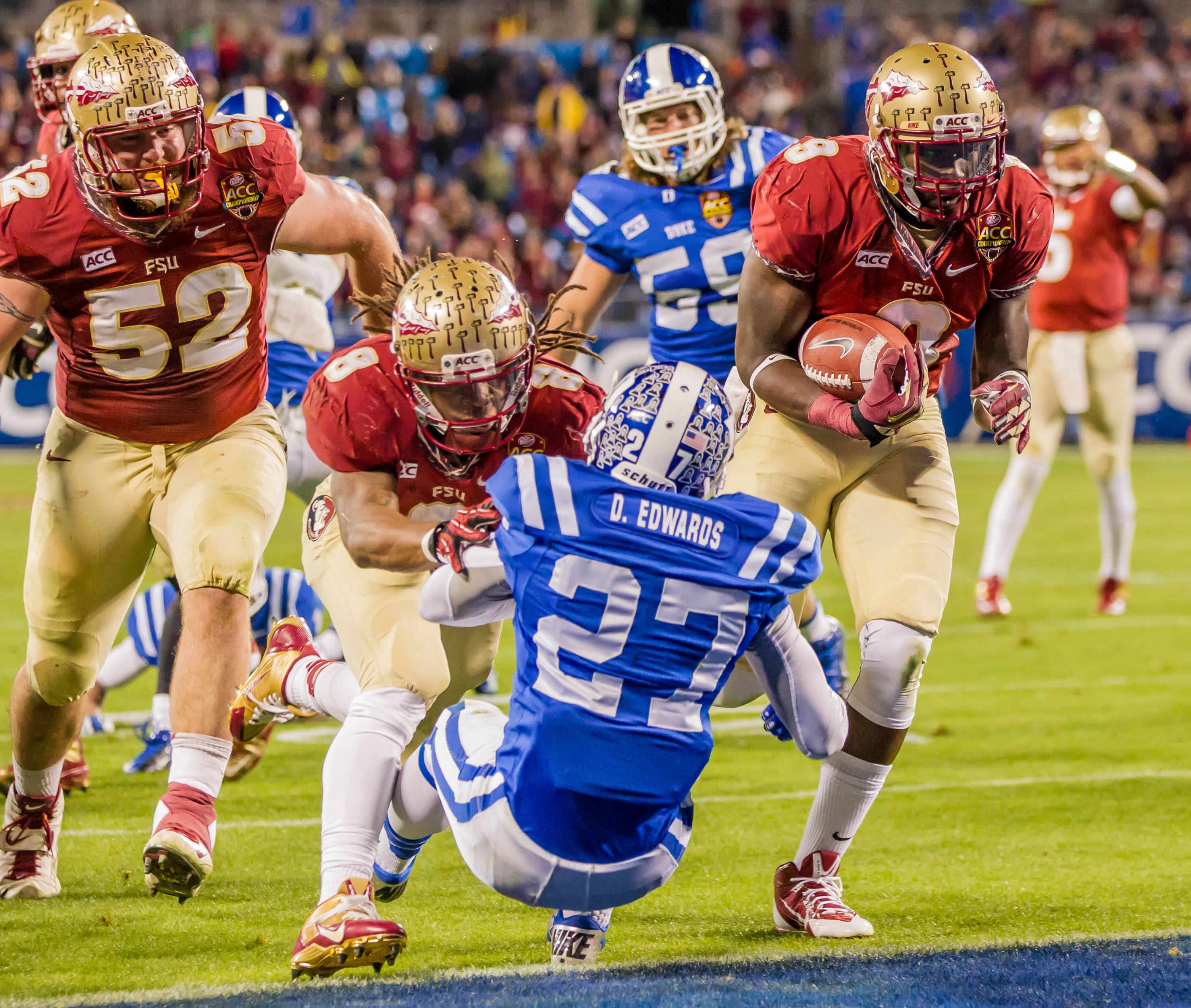 Karlos Williams (9) scores behind Devonta Freeman's (8) crunching block.