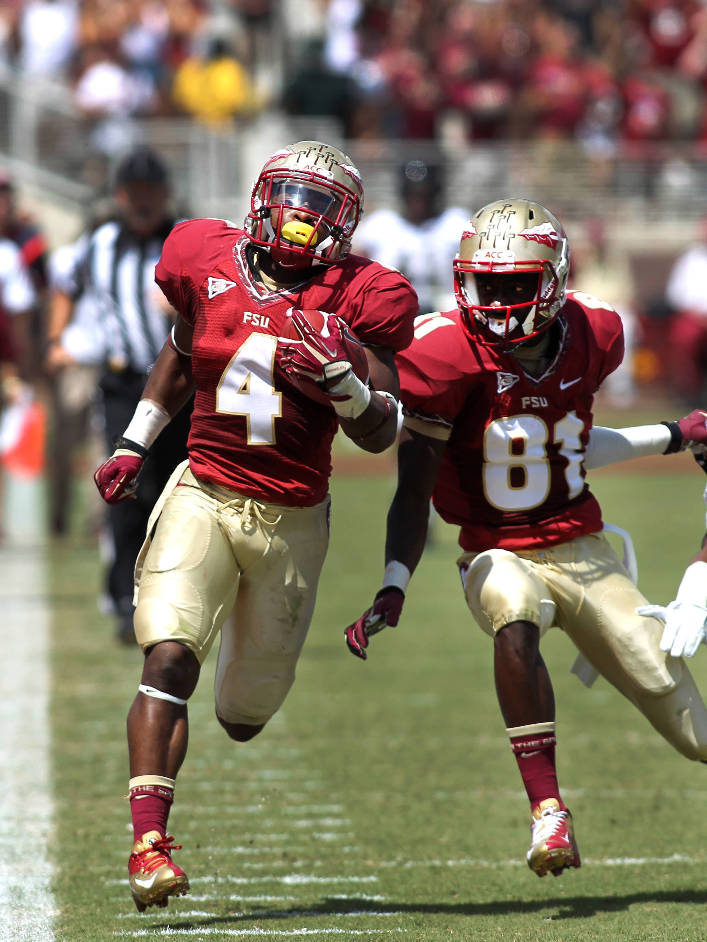 Chris Thompson (4) hugging the sideline on his touchdown run, FSU vs Wake Forest, 9/15/12 (Photo by Steve Musco)