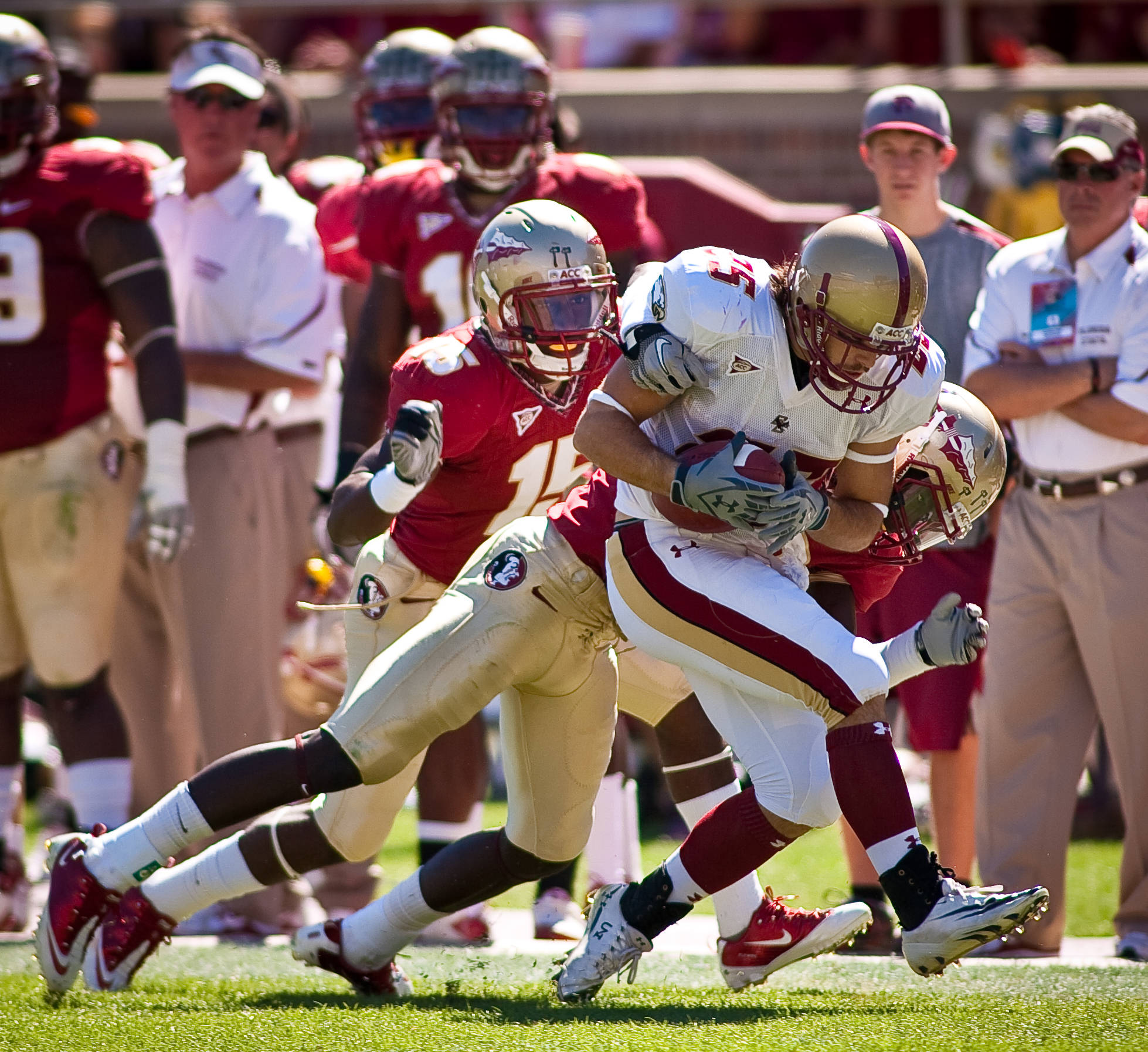 Seminole defenders make a tackle.
