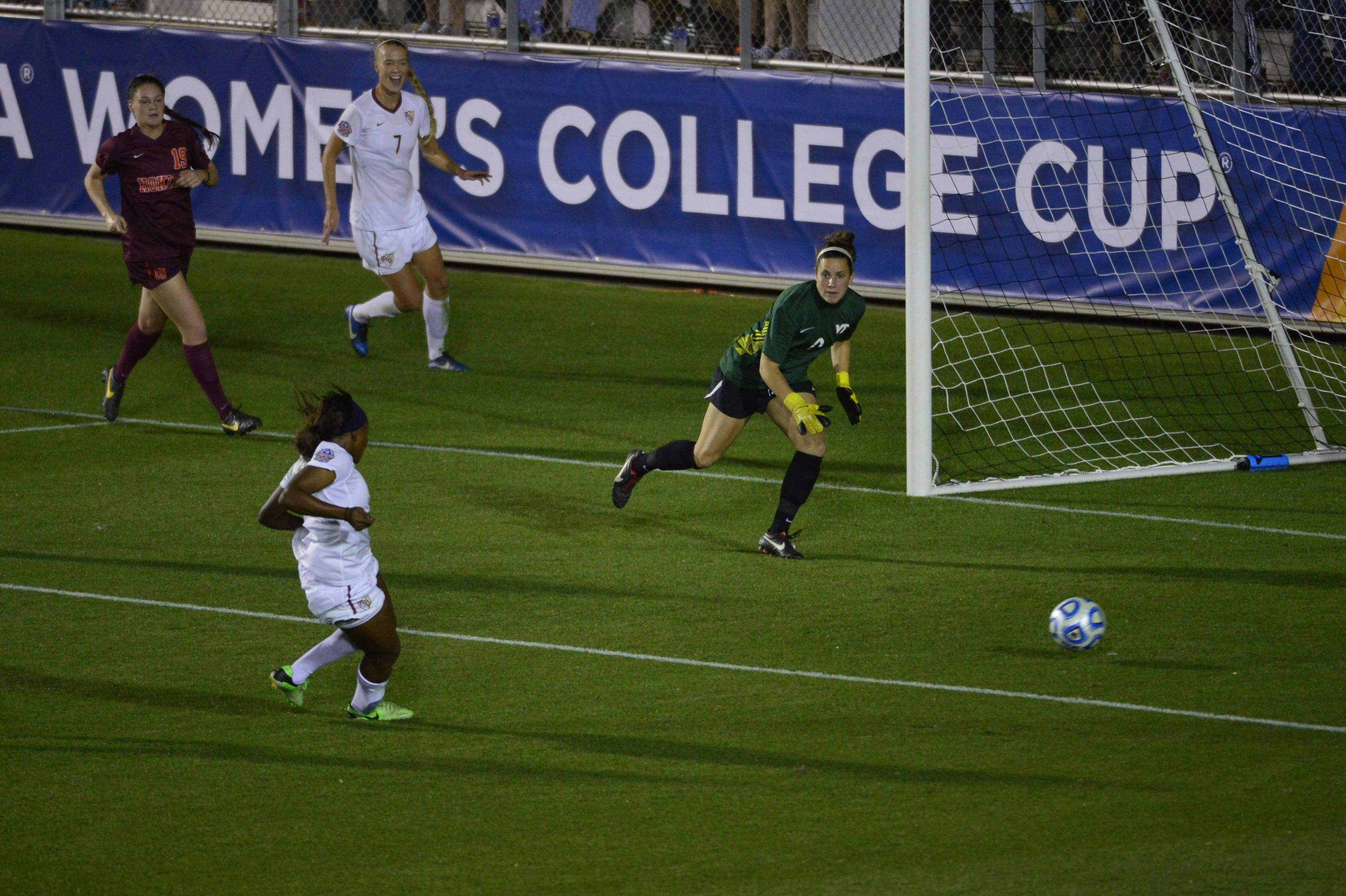 Dec 6, 2013; Cary, NC, USA; Florida State Seminoles midfielder Jamia Fields (4) scores a goal as midfielder Dagny Brynjarsdottir (7) looks on and Virginia Tech Hokies defender Jordan Coburn (19) and goalkeeper Cayle Colpitts (0) defend in the second half at WakeMed Soccer Park. Mandatory Credit: Bob Donnan-USA TODAY Sports
