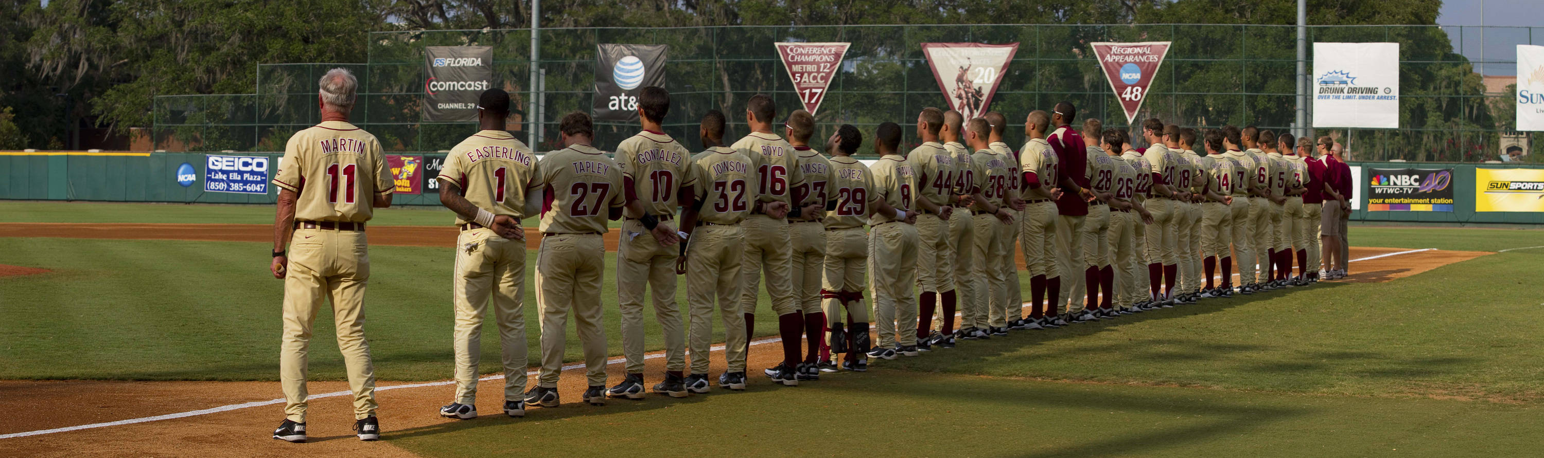 The Seminoles line up to honor the flag during the playing of the national anthem.