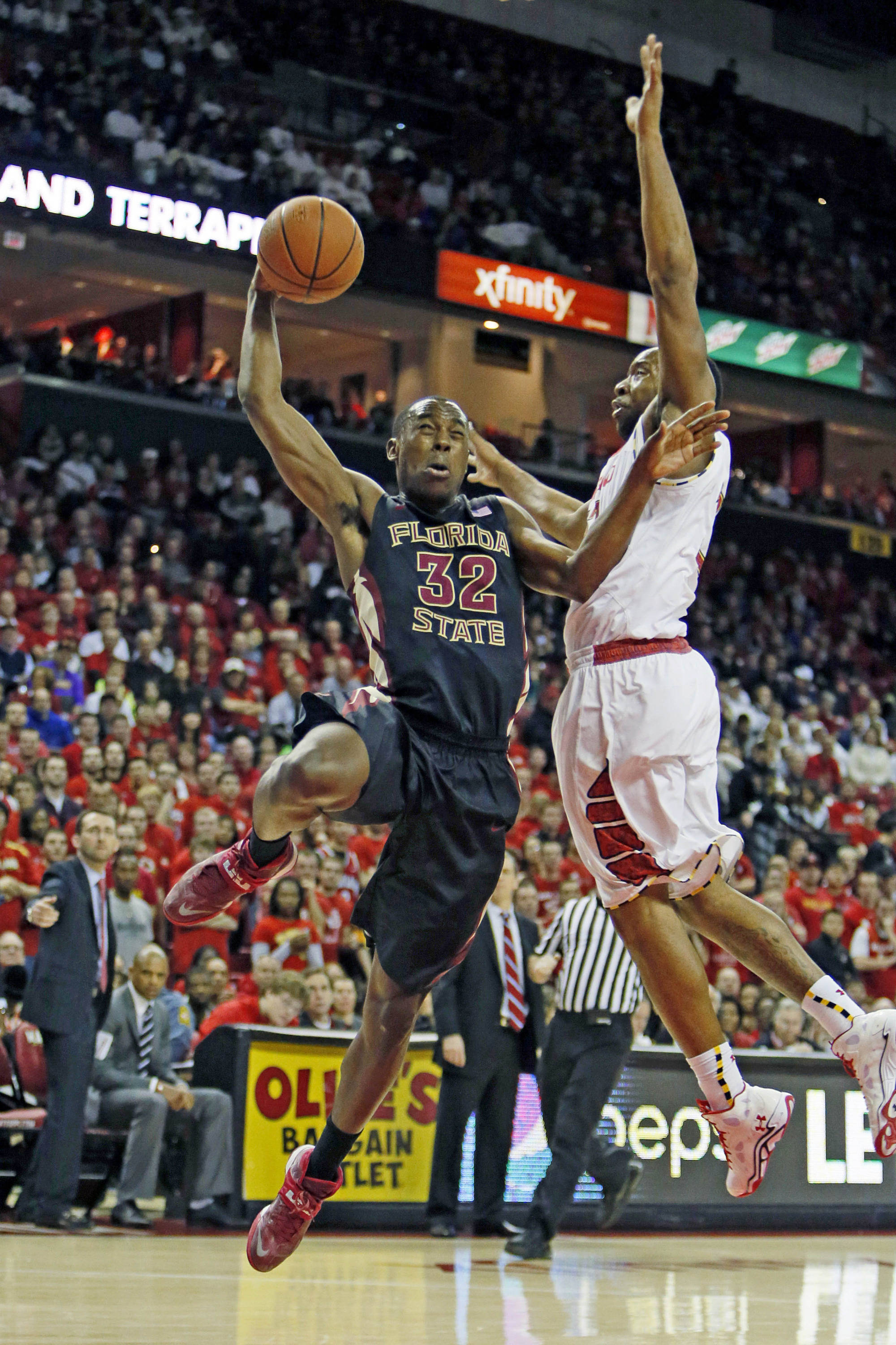 Feb 8, 2014; College Park, MD, USA; Florida State Seminoles guard Montay Brandon (32) has his shot blocked by Maryland Terrapins forward Dez Wells (32) at Comcast Center. Mandatory Credit: Mitch Stringer-USA TODAY Sports