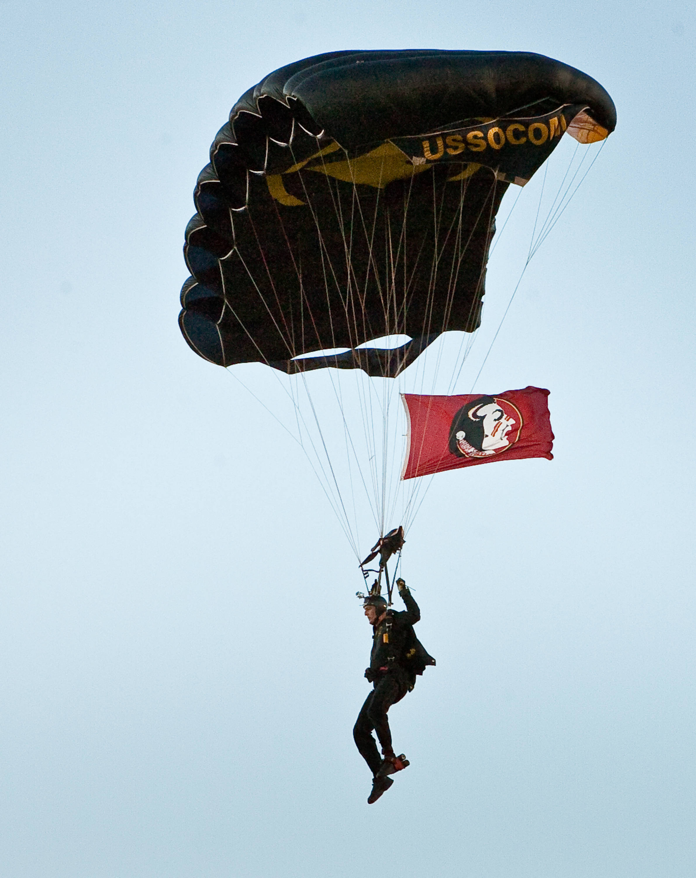 A paratrooper with the Florida State flag drops in on the Citrus Bowl before the Champs Sports Bowl.