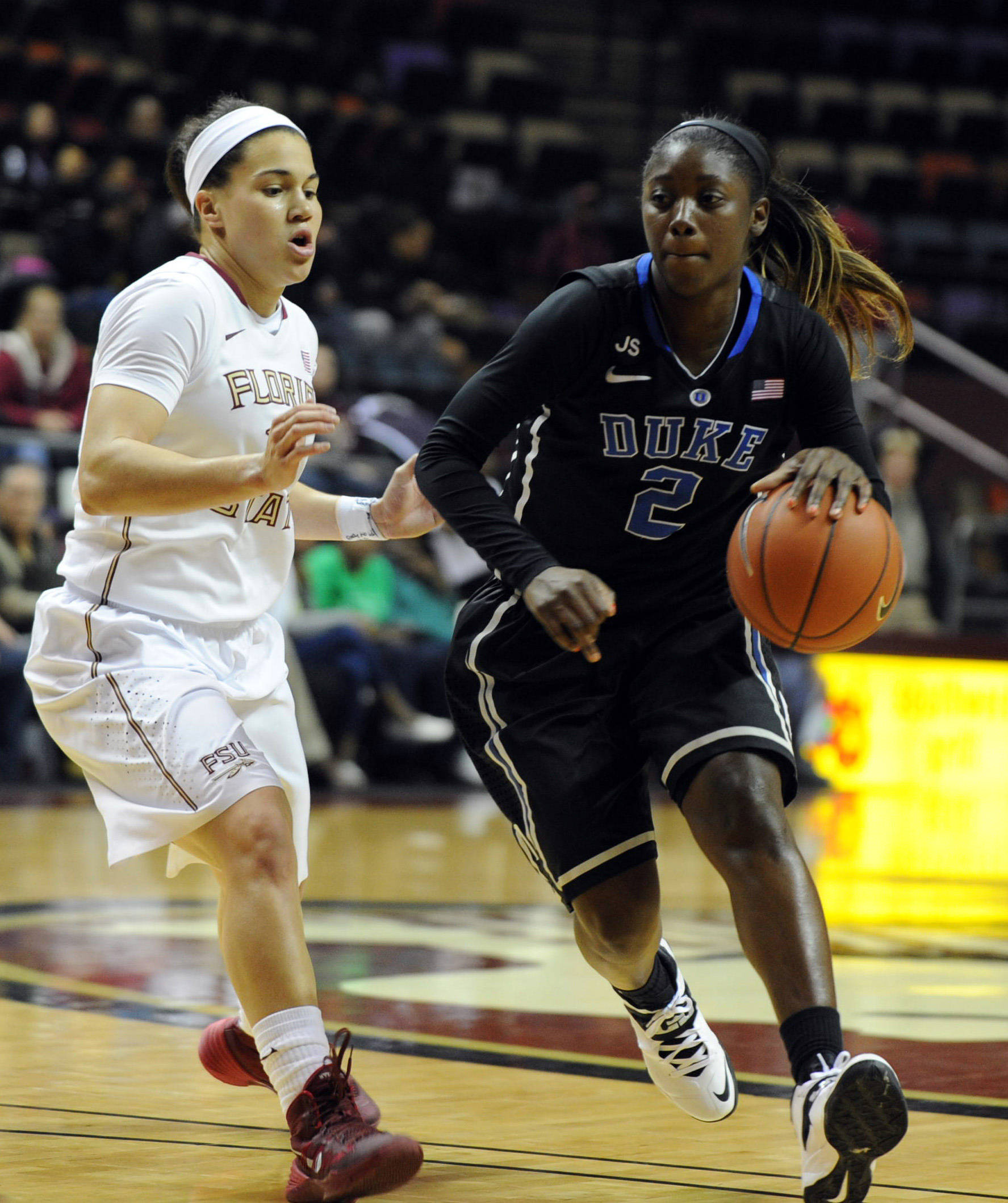 Jan 23, 2014; Tallahassee, FL, USA; Duke Blue Devils guard Alexis Jones (2) moves the ball past Florida State Seminoles guard Brittany Brown (12) during the first half of the game at the Donald L. Tucker Center (Tallahassee). Mandatory Credit: Melina Vastola-USA TODAY Sports