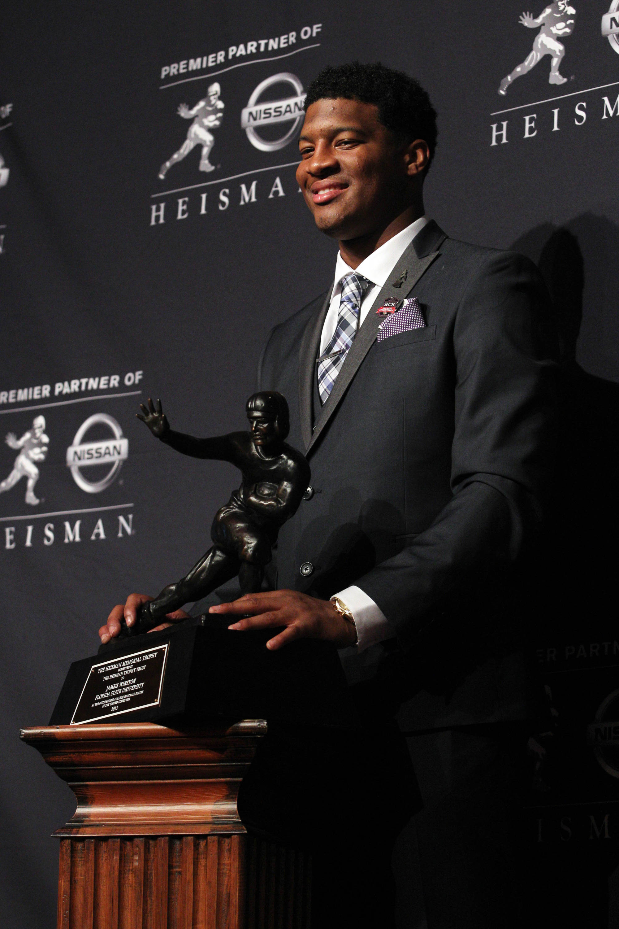 Dec 14, 2013; New York, NY, USA; Seminoles quarterback Jameis Winston poses for a photo after being awarded the 2013 Heisman Trophy. Adam Hunger-USA TODAY Sports