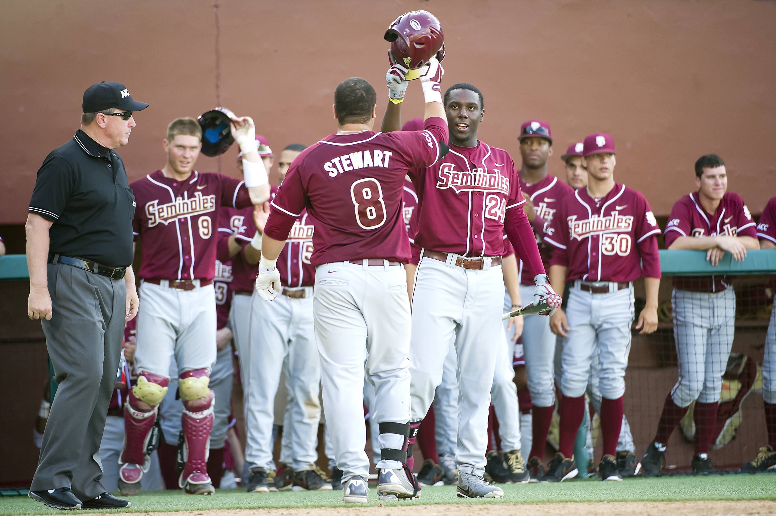 FSU players congratulate DJ Stewart after a home run