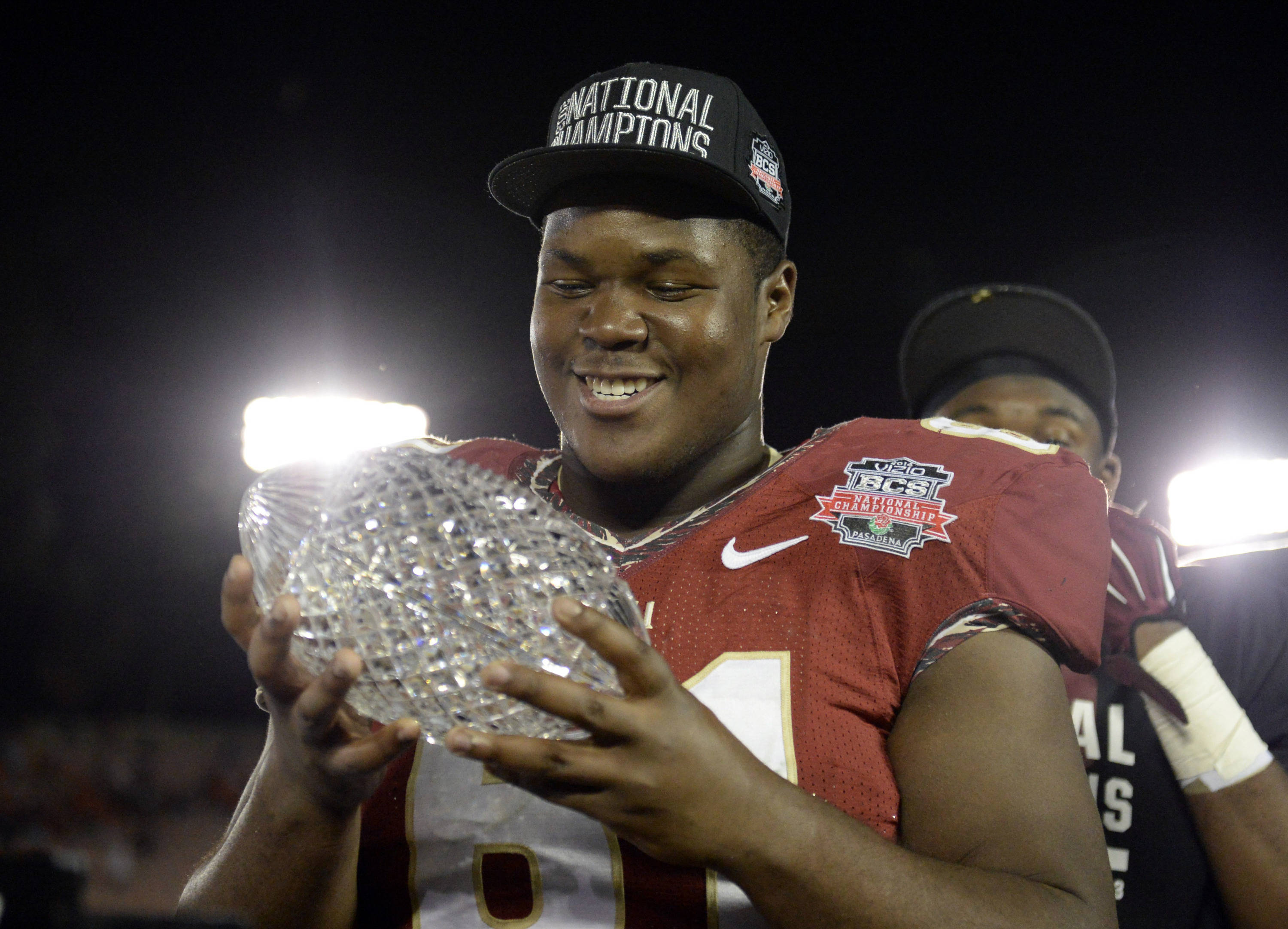 Jan 6, 2014; Pasadena, CA, USA; Florida State Seminoles offensive linesman Myles Davis (61) celebrates with the Coaches Trophy after winning the 2014 BCS National Championship game against Auburn Tigers 34-31 at the Rose Bowl.  Mandatory Credit: Richard Mackson-USA TODAY Sports